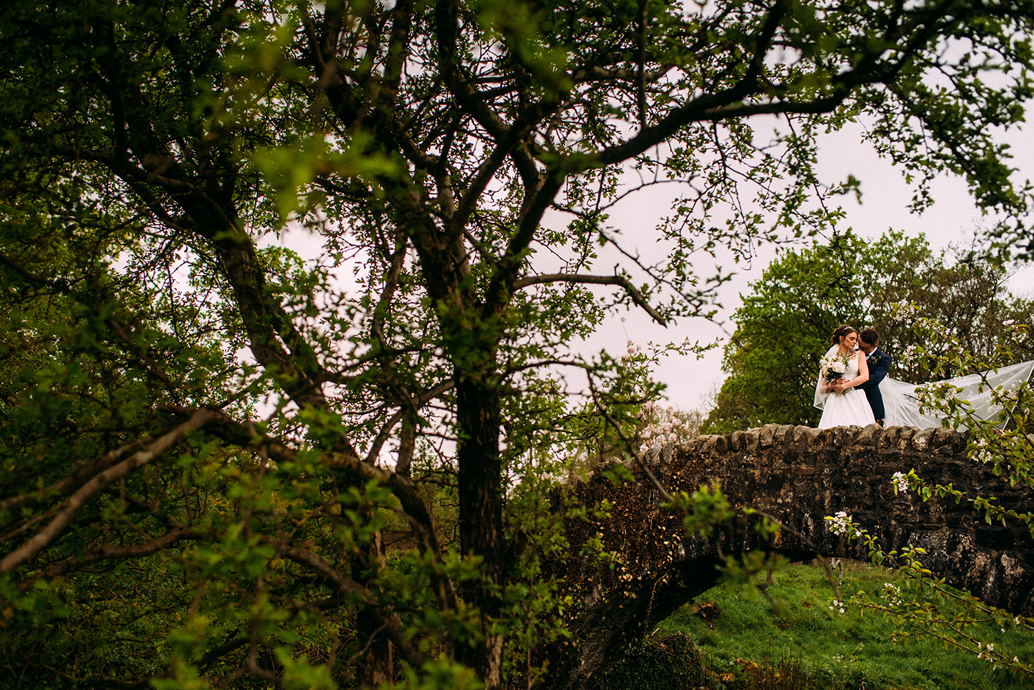 Bride and groom on the bridge together at the Out barn wedding venue