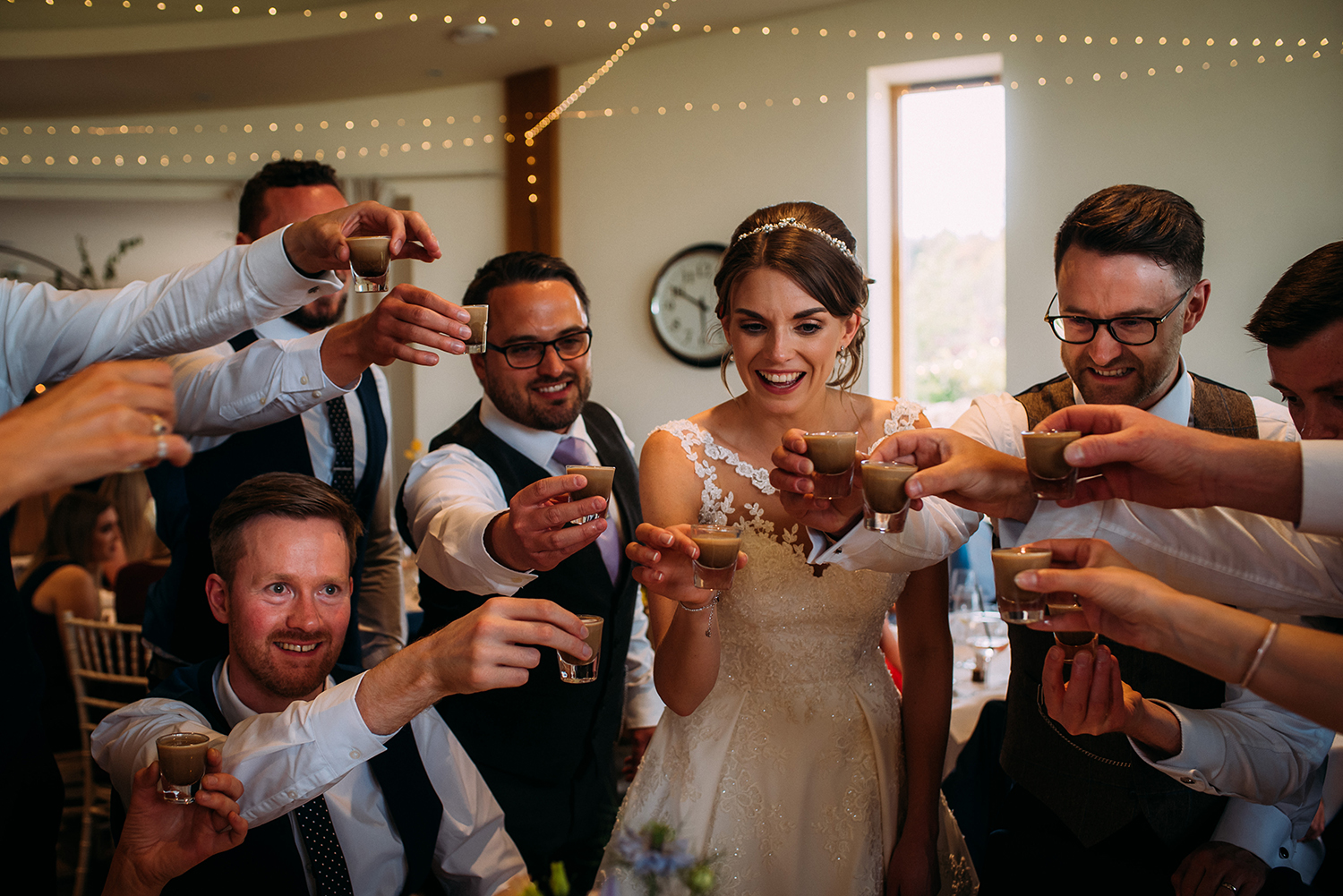 bride groom and friends doing shots together