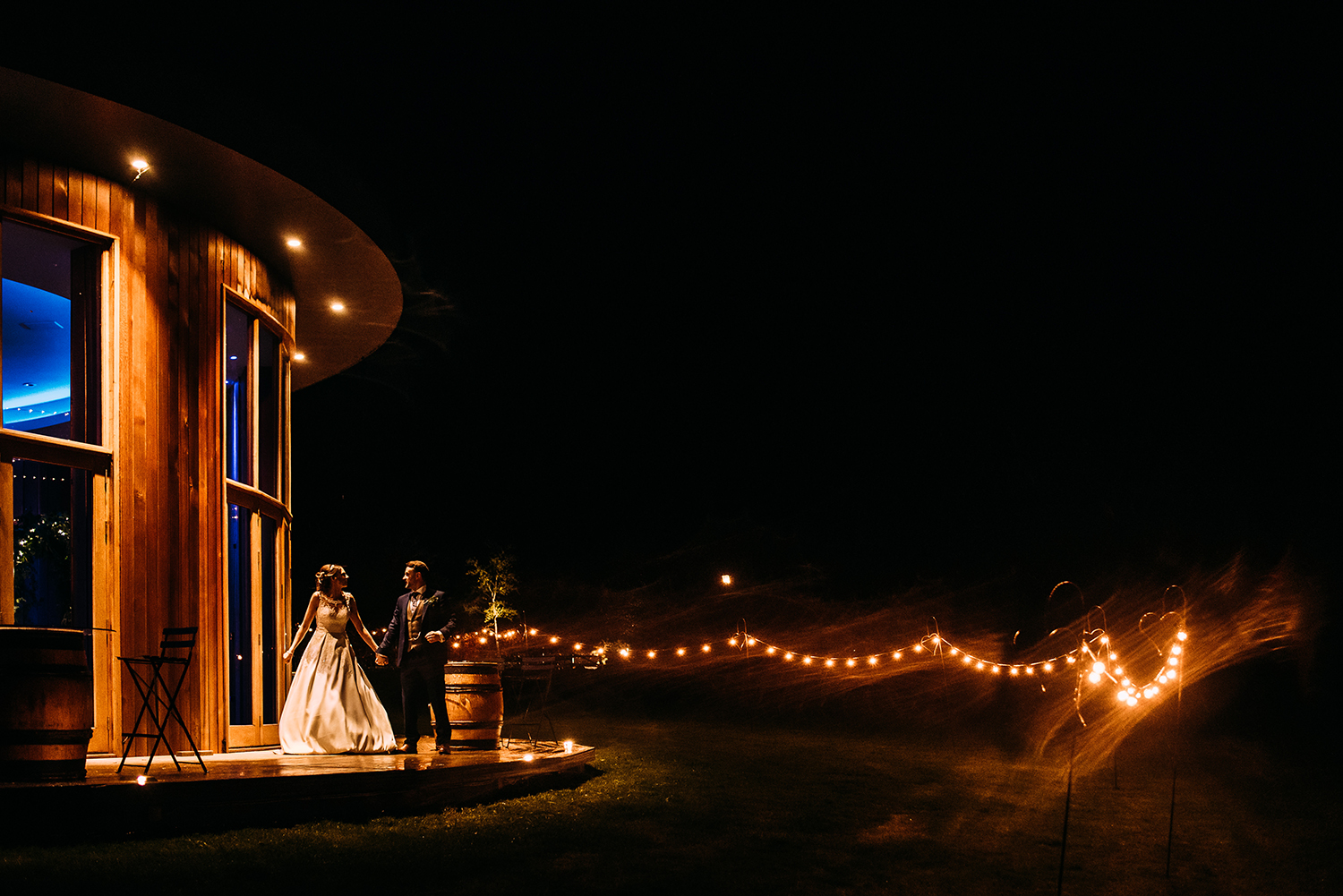 Bride and groom outside the Out barn wedding venue at night