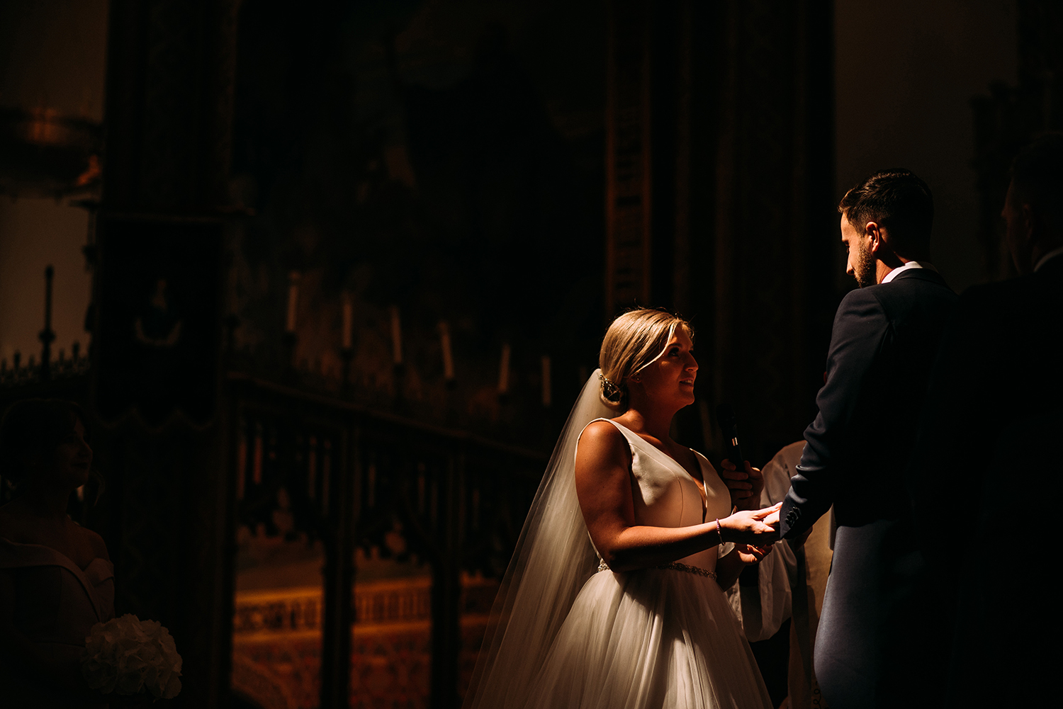 bride and groom in amazing light at church