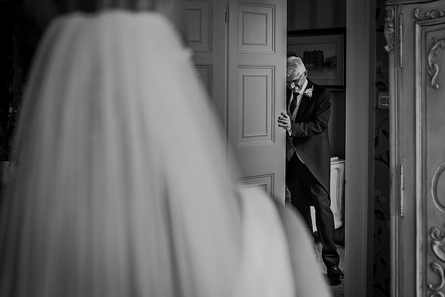 bw photo of dads reaction to first seeing his daughter