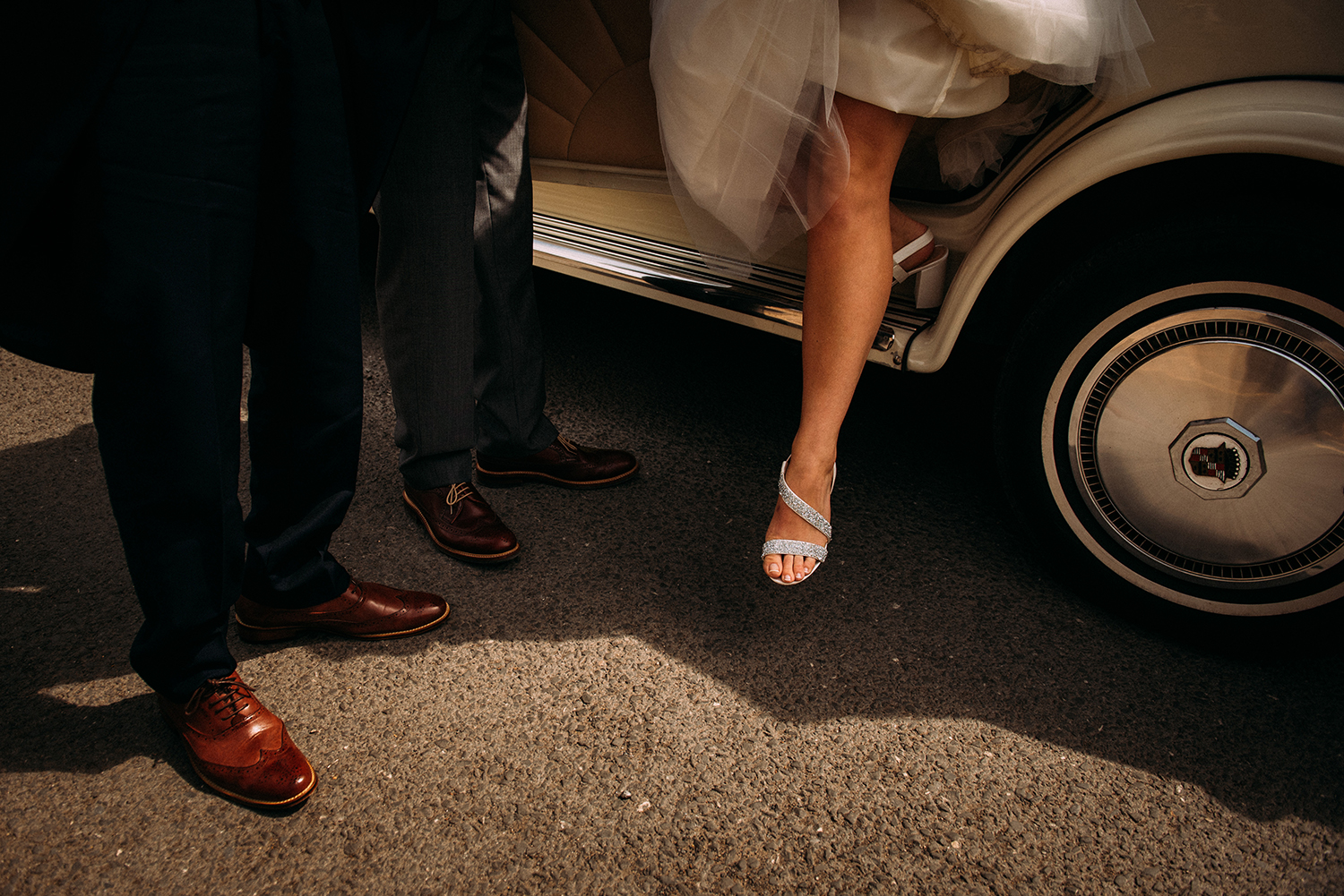 brides foot stepping out of the car