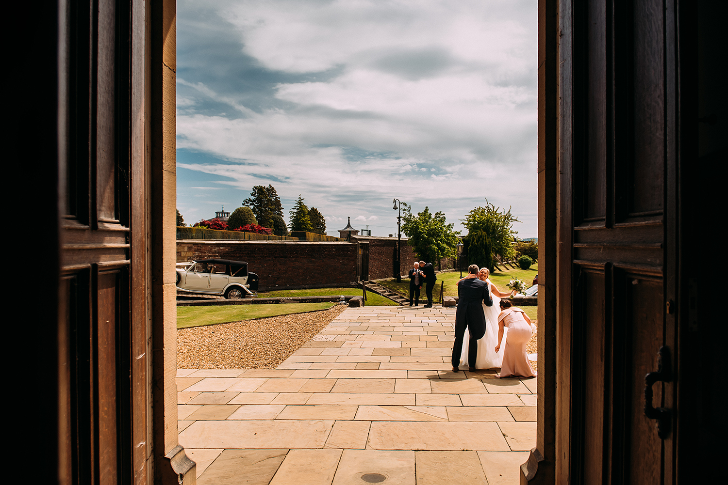 bride hugging guest as arriving at church