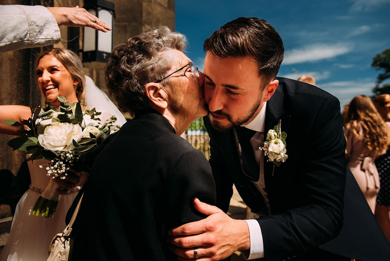 groom and grandma hug/kiss