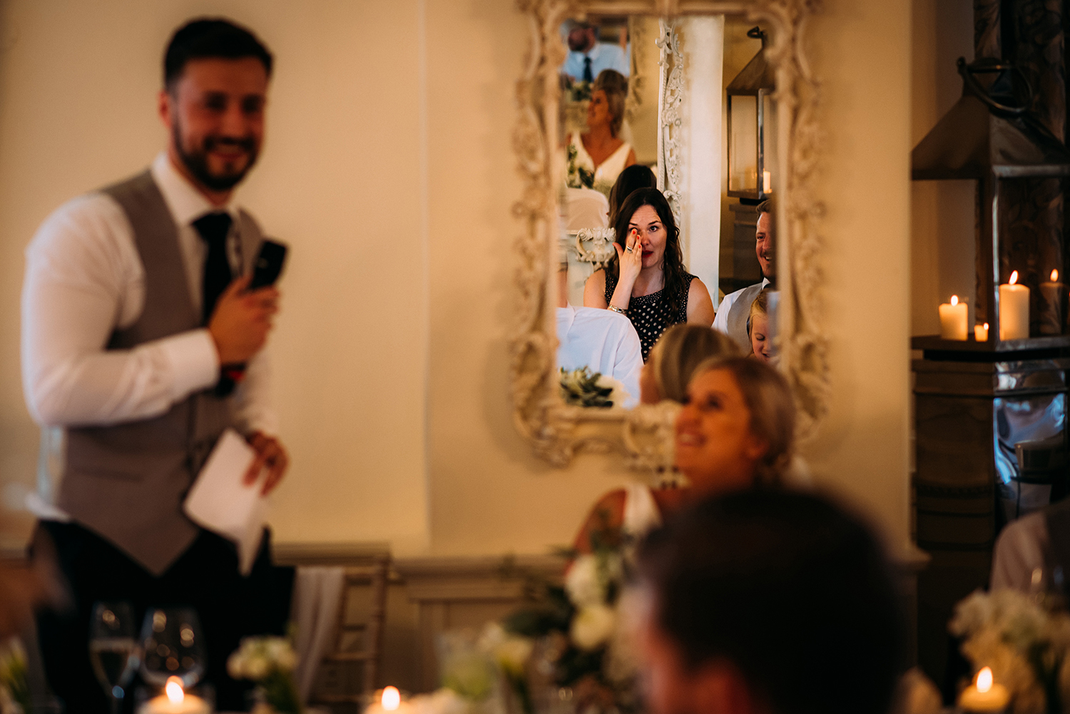 reflection of a guest wiping a tear during the speeches