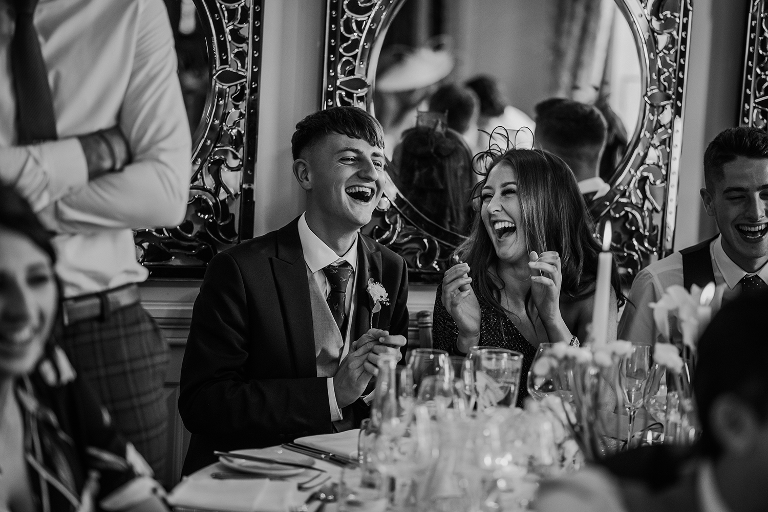 bw photo of the guests laughing at Eaves Hall