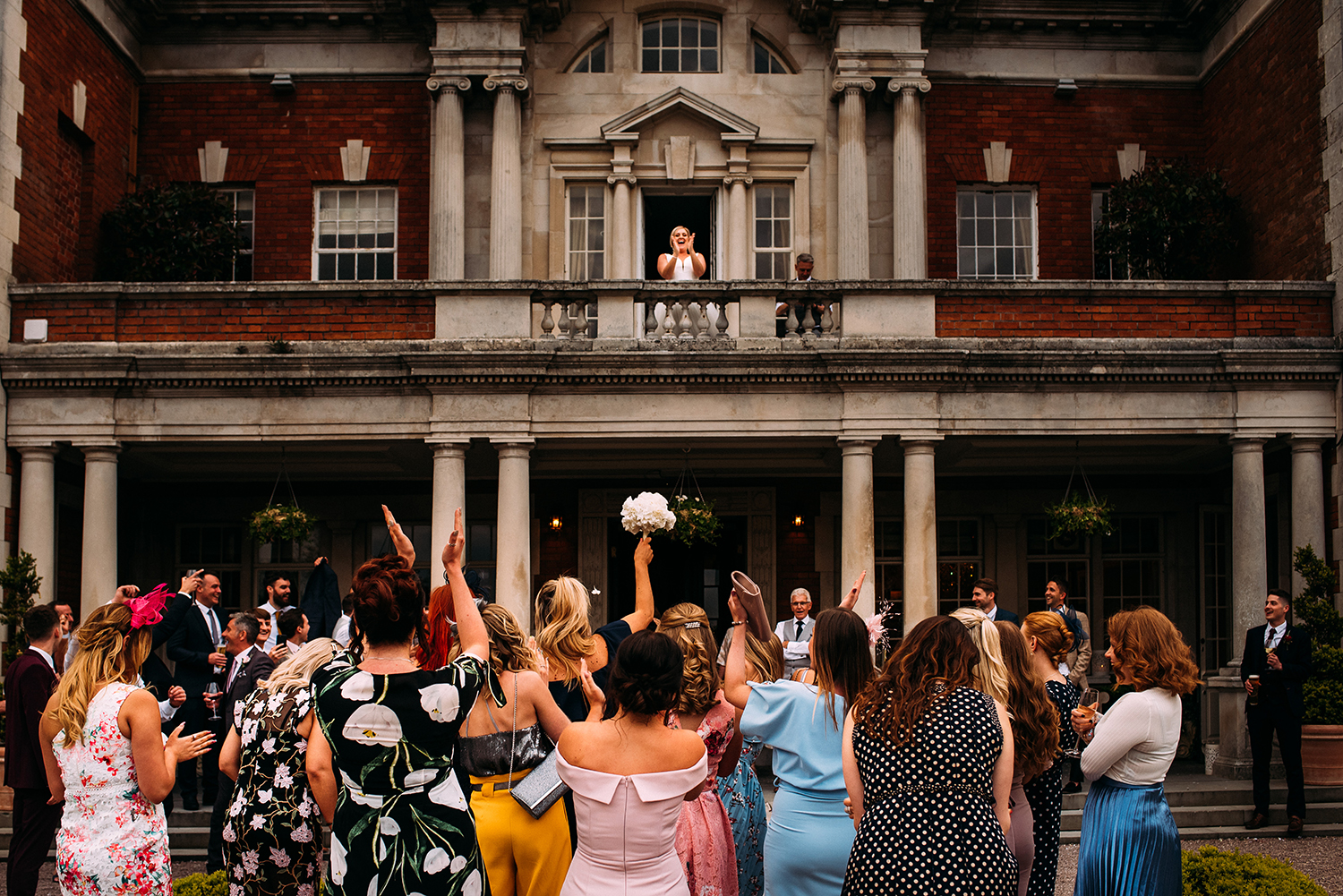 bouquet toss at Eaves hall