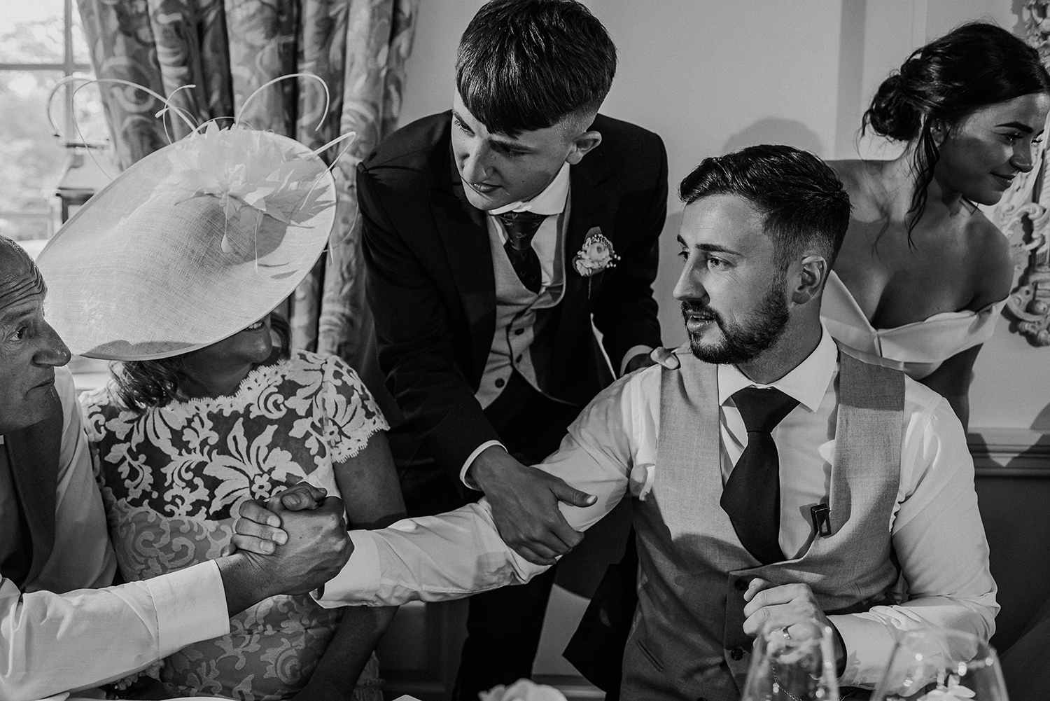 black and white photo of guests with the groom
