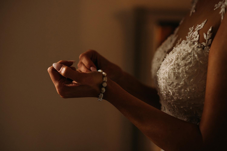bride fastens bracelet
