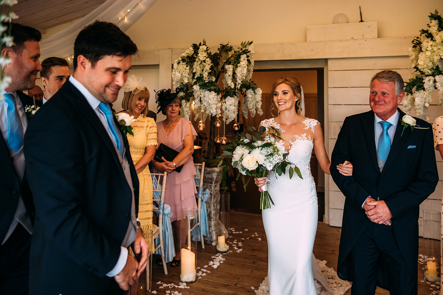 bride and her father enter the ceremony at Bashall Barn