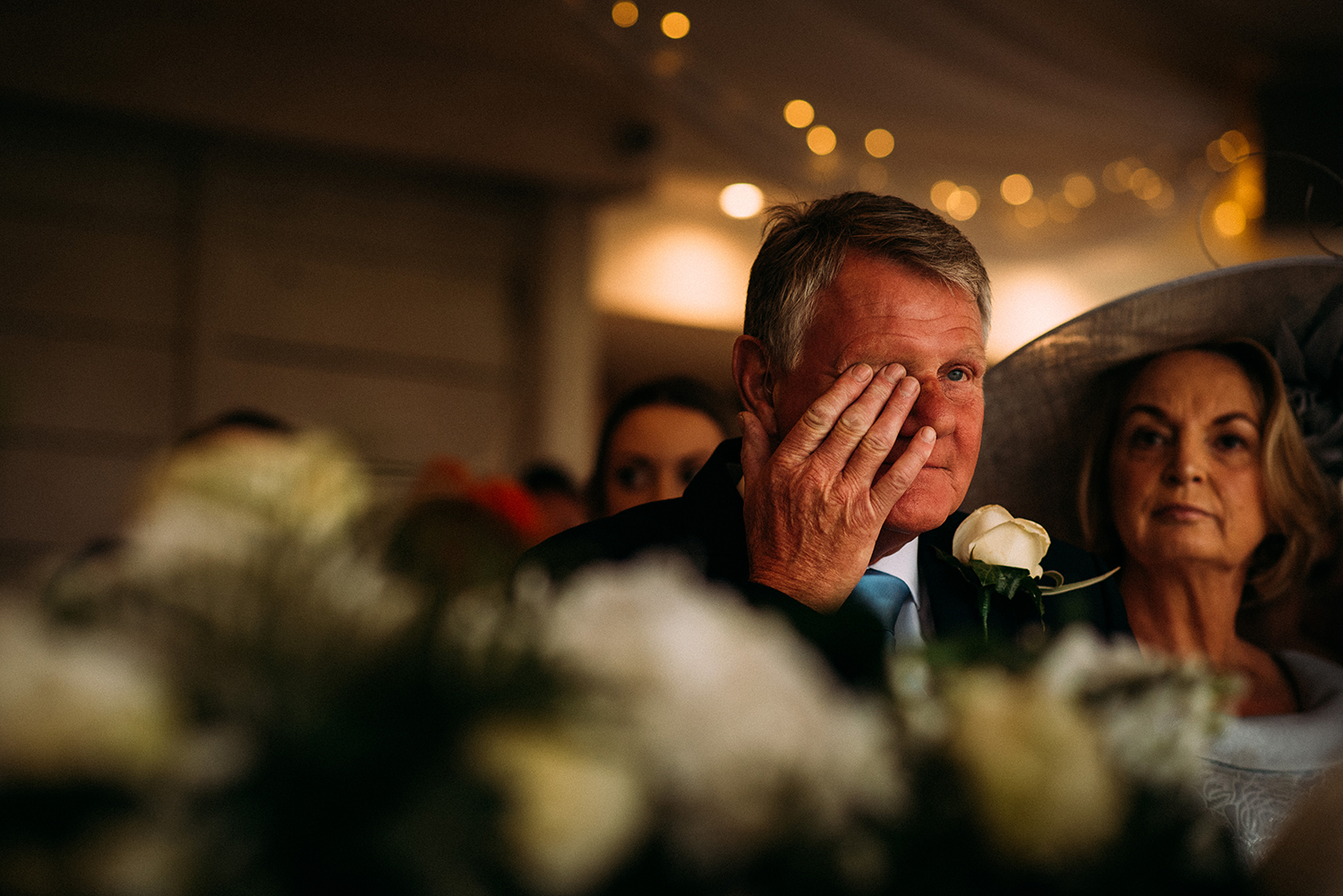 brides father wipes tears