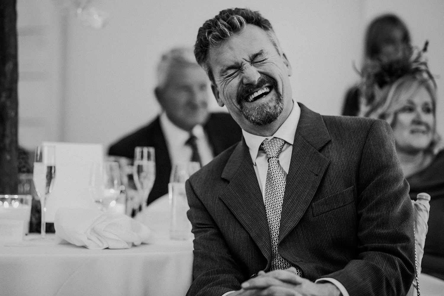 bw photo of guest laughing