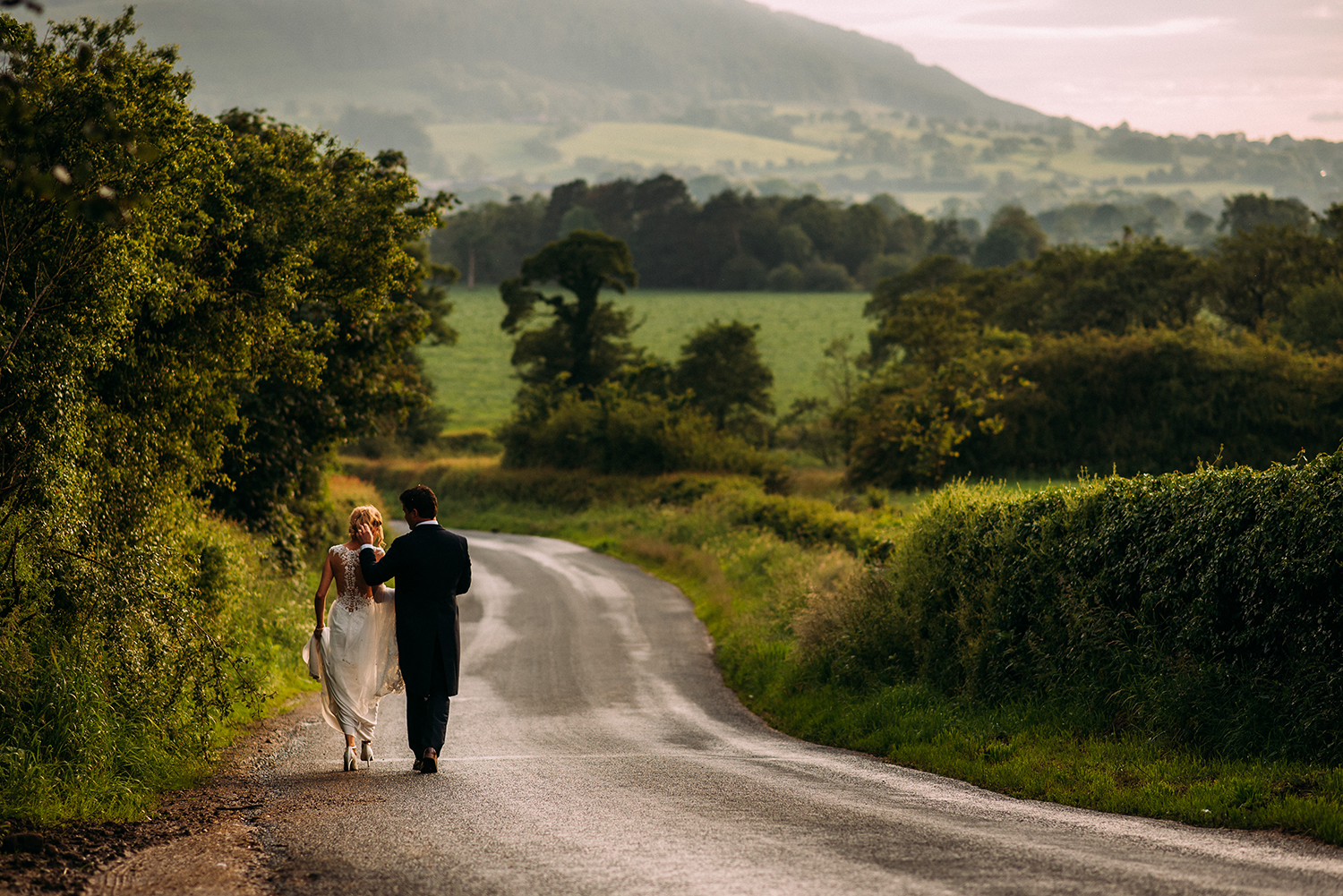 bride and groom walk down the road