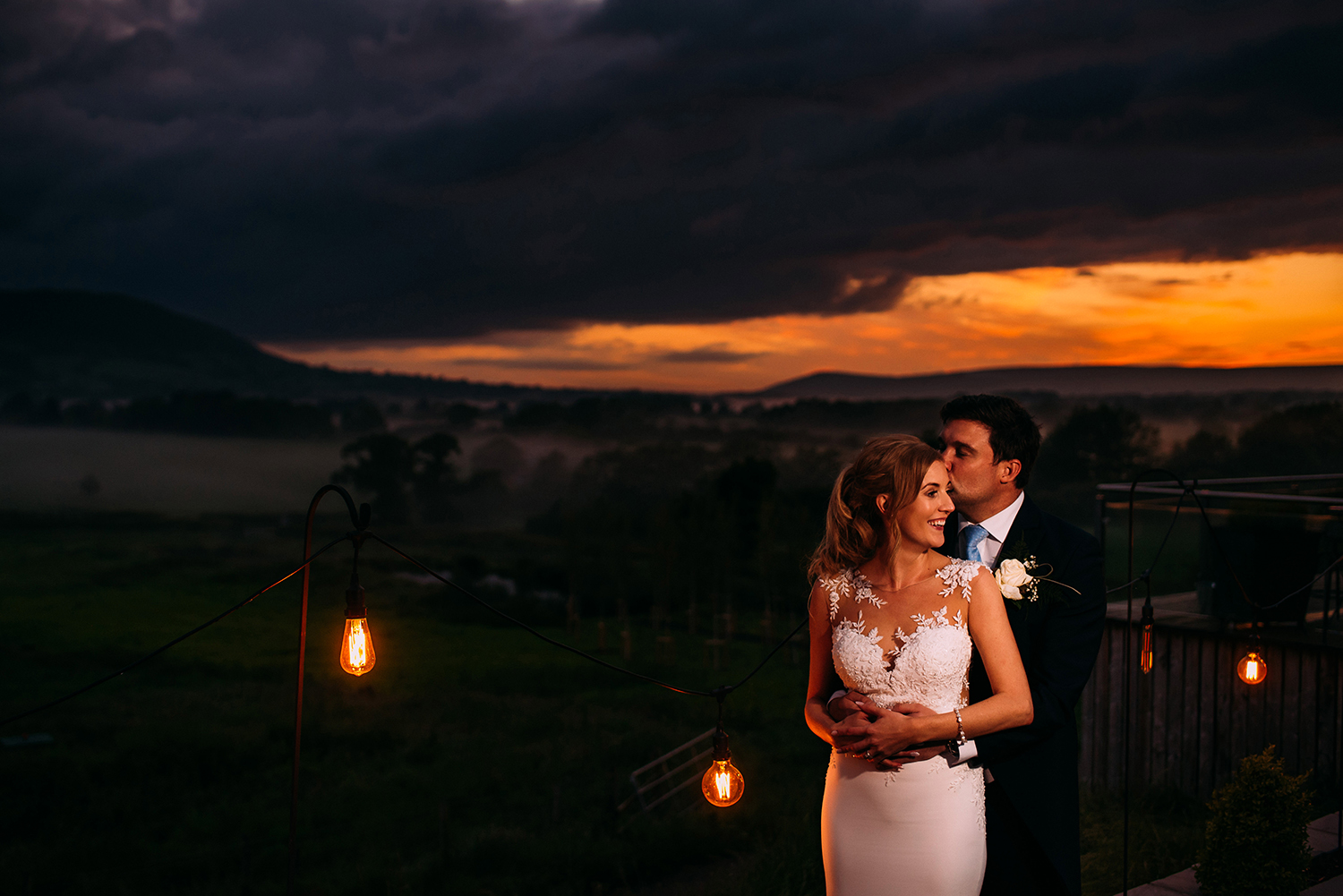 bride and groom in gorgeous sunset overlooking the valley at bashall barn