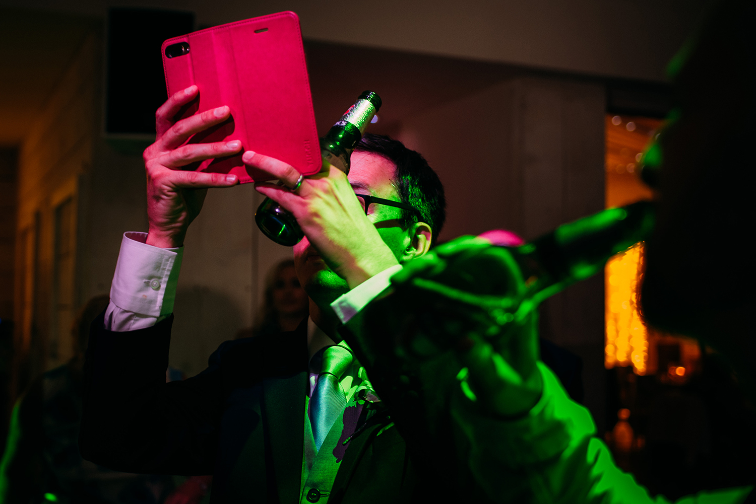 bright pink and green photo of a guest taking a photo