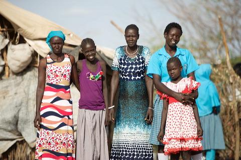 Sarah far right in blue blouse, with her family, Kakuma Refugee Camp photo: Jjumba Martin