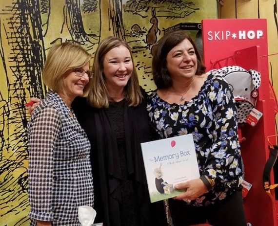 "Joanna at the book launch for ""The Memory Box"" accompanied by two mothers who had lost a child. The illustrator drew a special picture in the book for each of these mothers to honor their children."