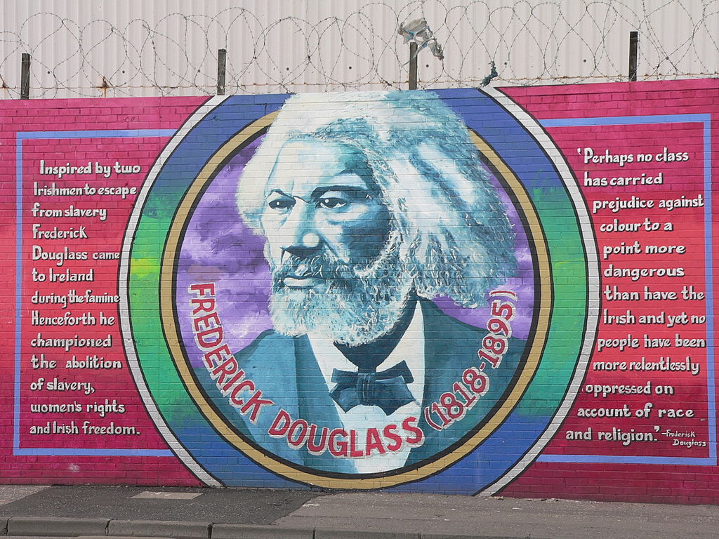 "Frederick Douglass Mural on the ""Solidarity Wall"" in Belfast. Image via Wikimedia Commons; photo credit: Laurence."