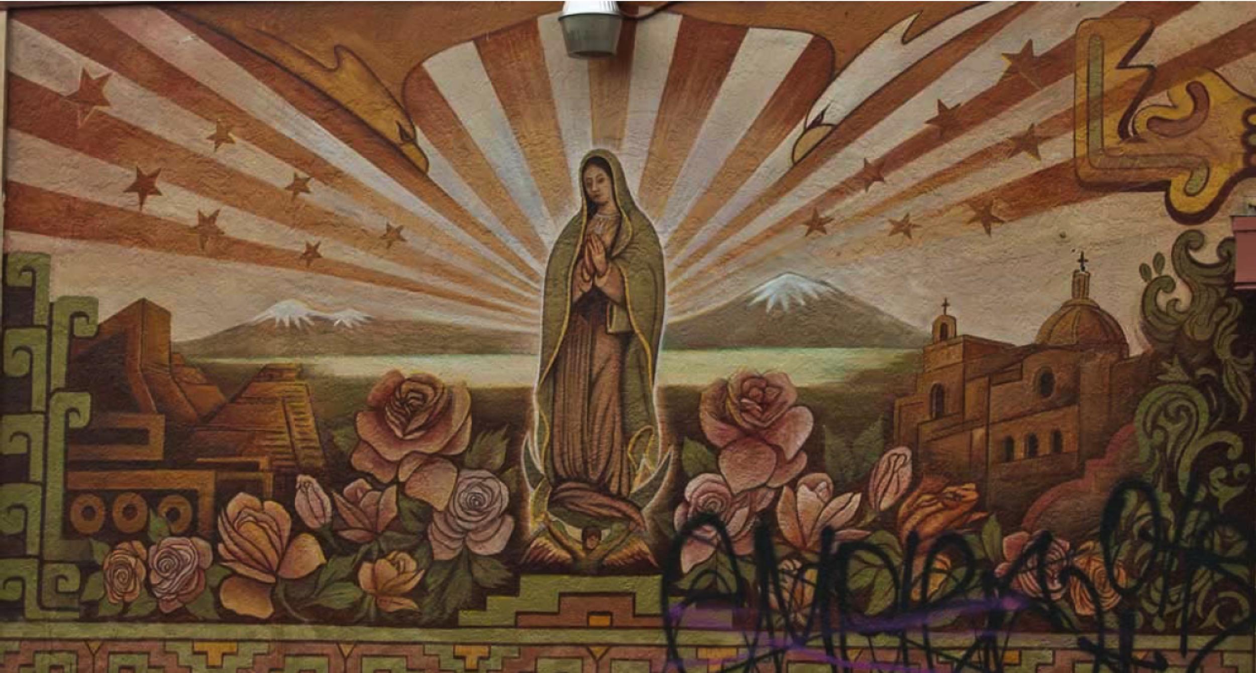 A mural adorns a wall along International Boulevard