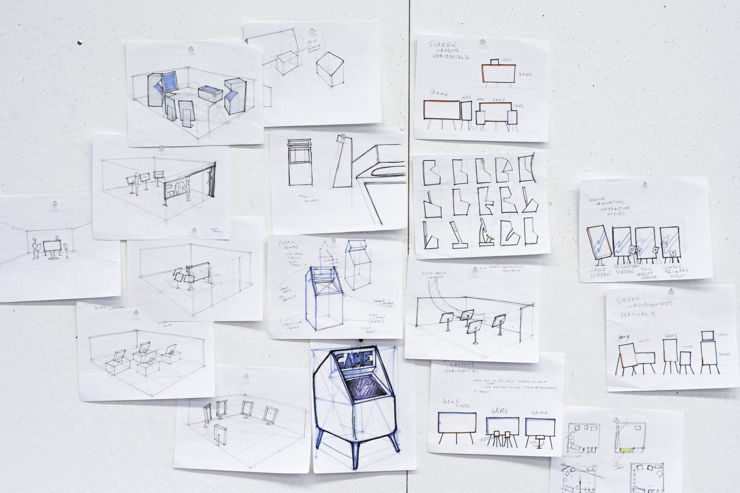 Ideation and Development - Early on, the team decided to create an arcade to display these games, but we didn't quite know what the room would look like, or what the arcade cabinets would be. So I got to sketching.