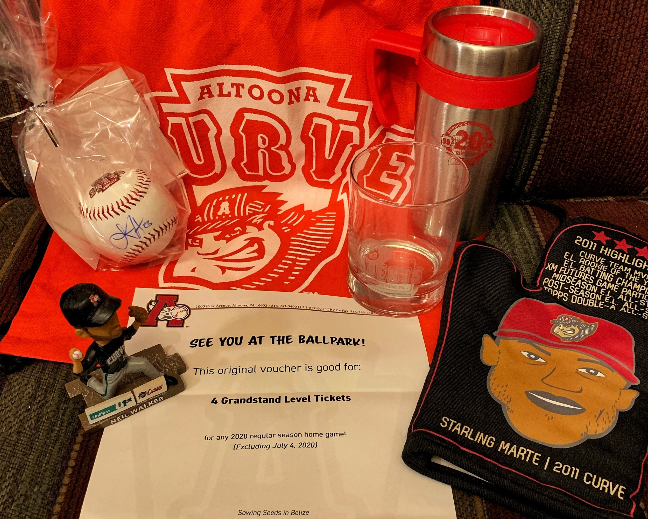 Altoona Curve Gift Pack - This pack includes: 4 Grandstand tickets for the 2020 season, a tumbler, insulated mug, bobble-head, autographed baseball, and a Collectors Starling Marte oven mit.Estimated Value $100