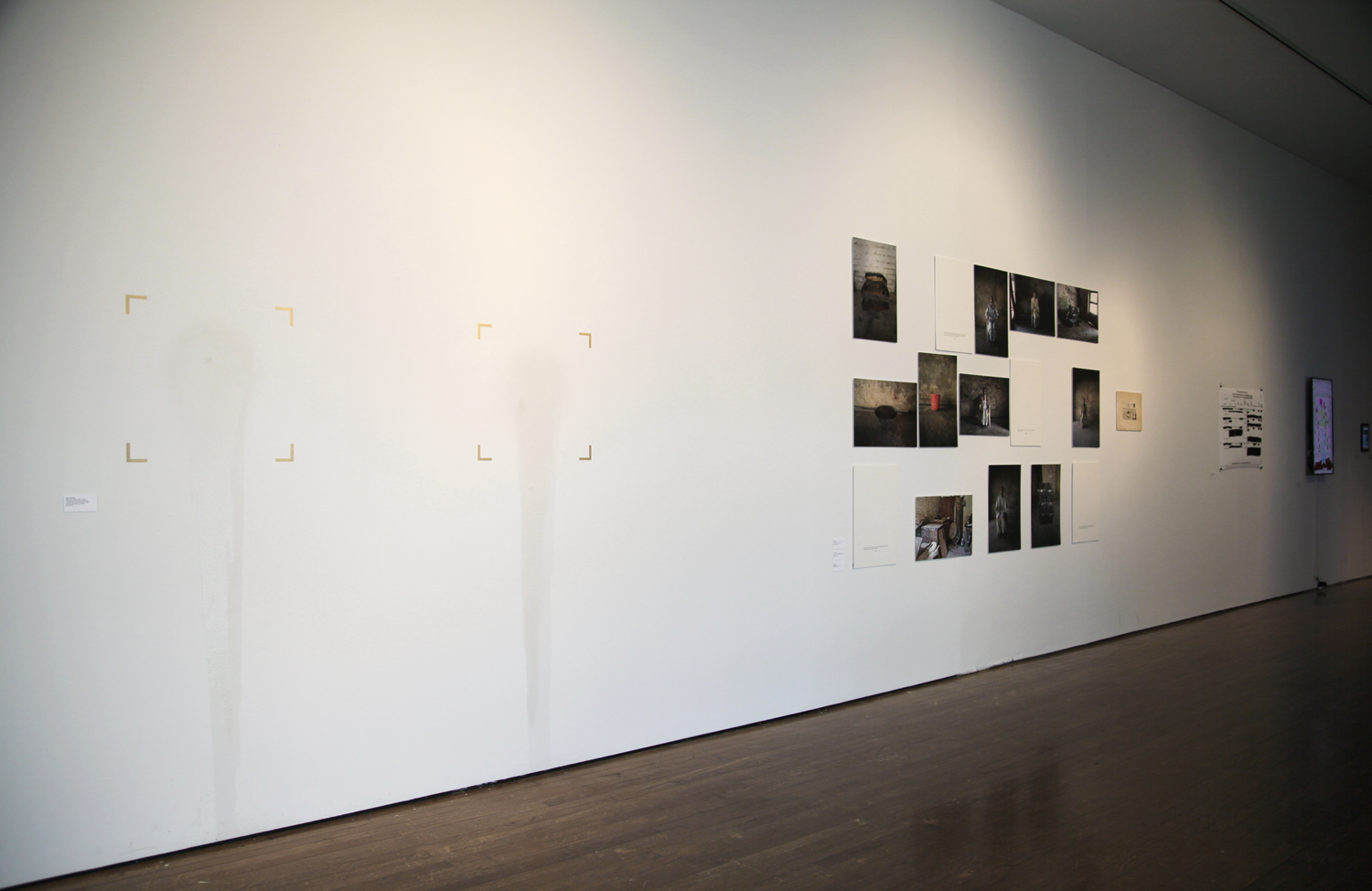 Exhibition view with Raja'a Khalid,  Black Agar, Black Agar  (2016) in foreground, photograph by Sadia Shirazi.