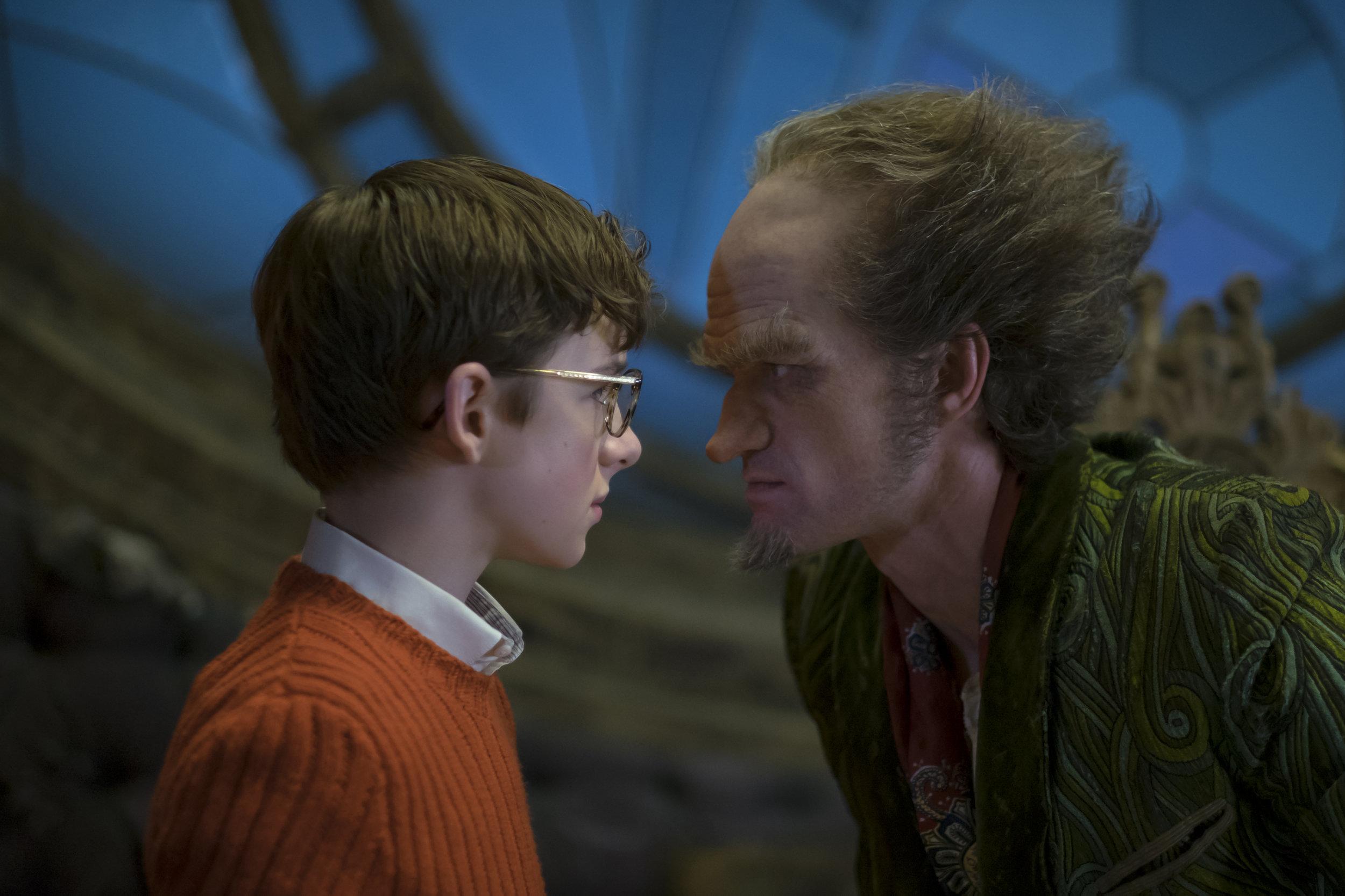 Joe Lederer/Netflix -  Louis Hynes  as Klaus Baudelaire and  Neil Patrick Harris  as Count Olaf