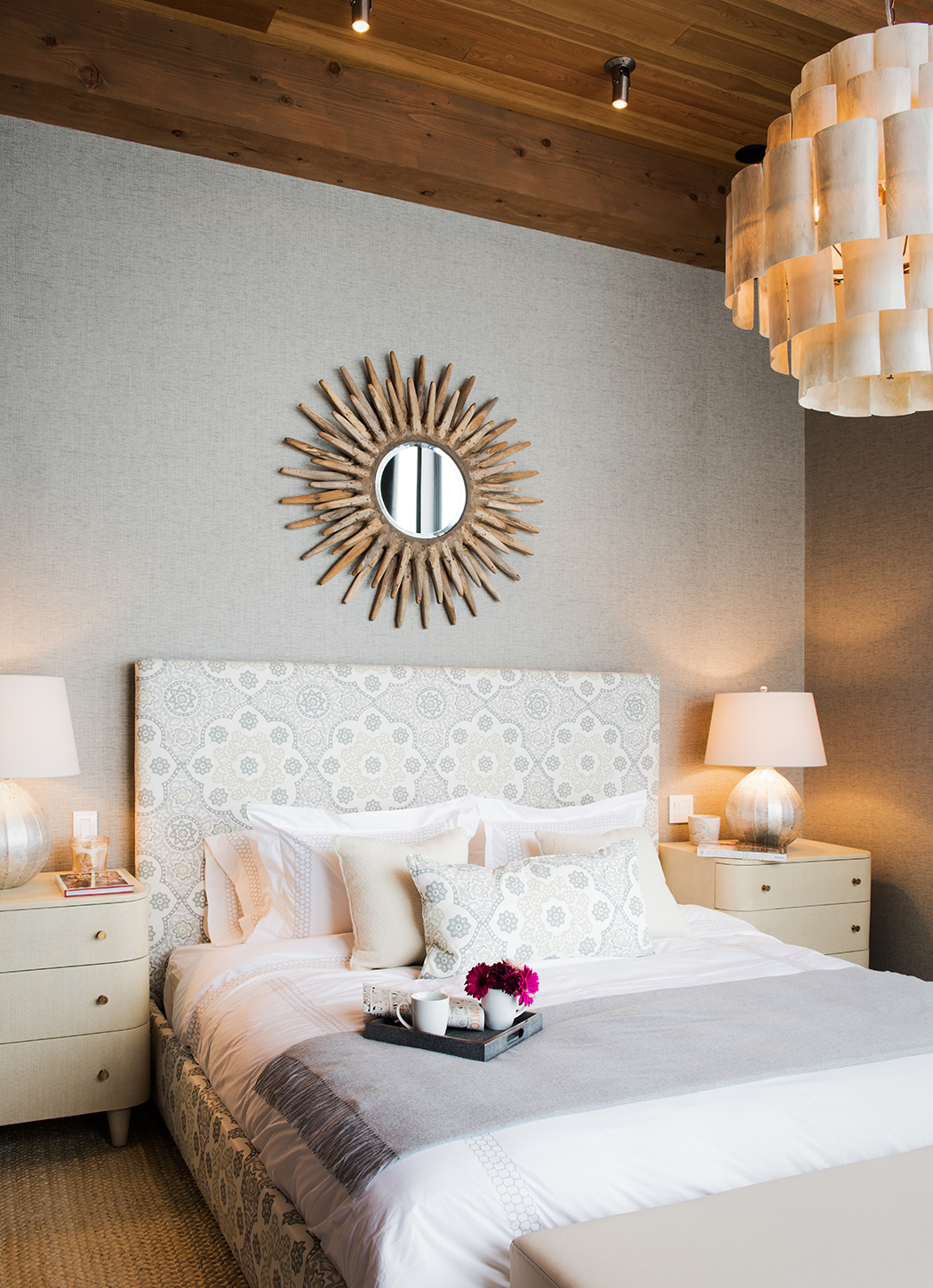 I love this bedroom, the interior designers did a great job with the furnishings! The pink in the flowers added the extra pop of color to really draw in your eye.