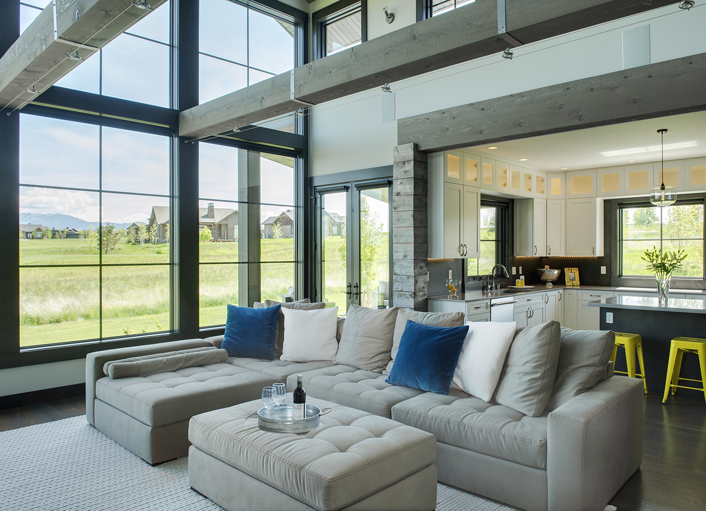 I love the large beams and the barnwood accents in this home.  The open floorplan creates the perfect entertaining environment.  The french doors go right out to the spacious patio overlooking the   Black Bull   golf course.