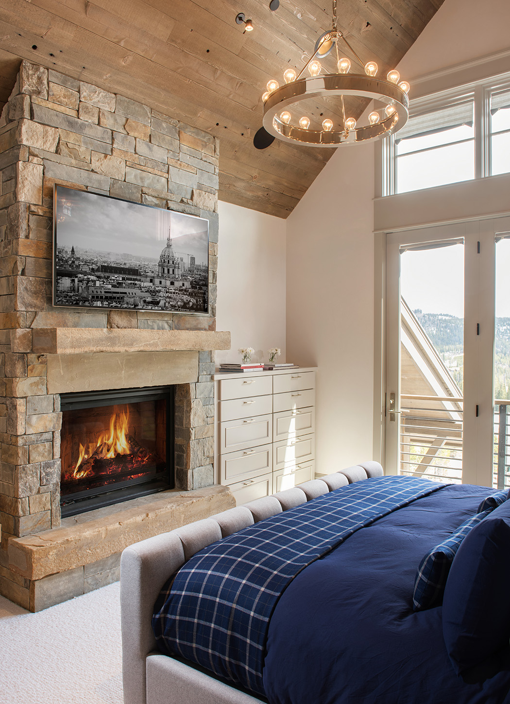 I love the cozy bedrooms.  The floor-to-ceiling fireplace adds that touch of warmth!