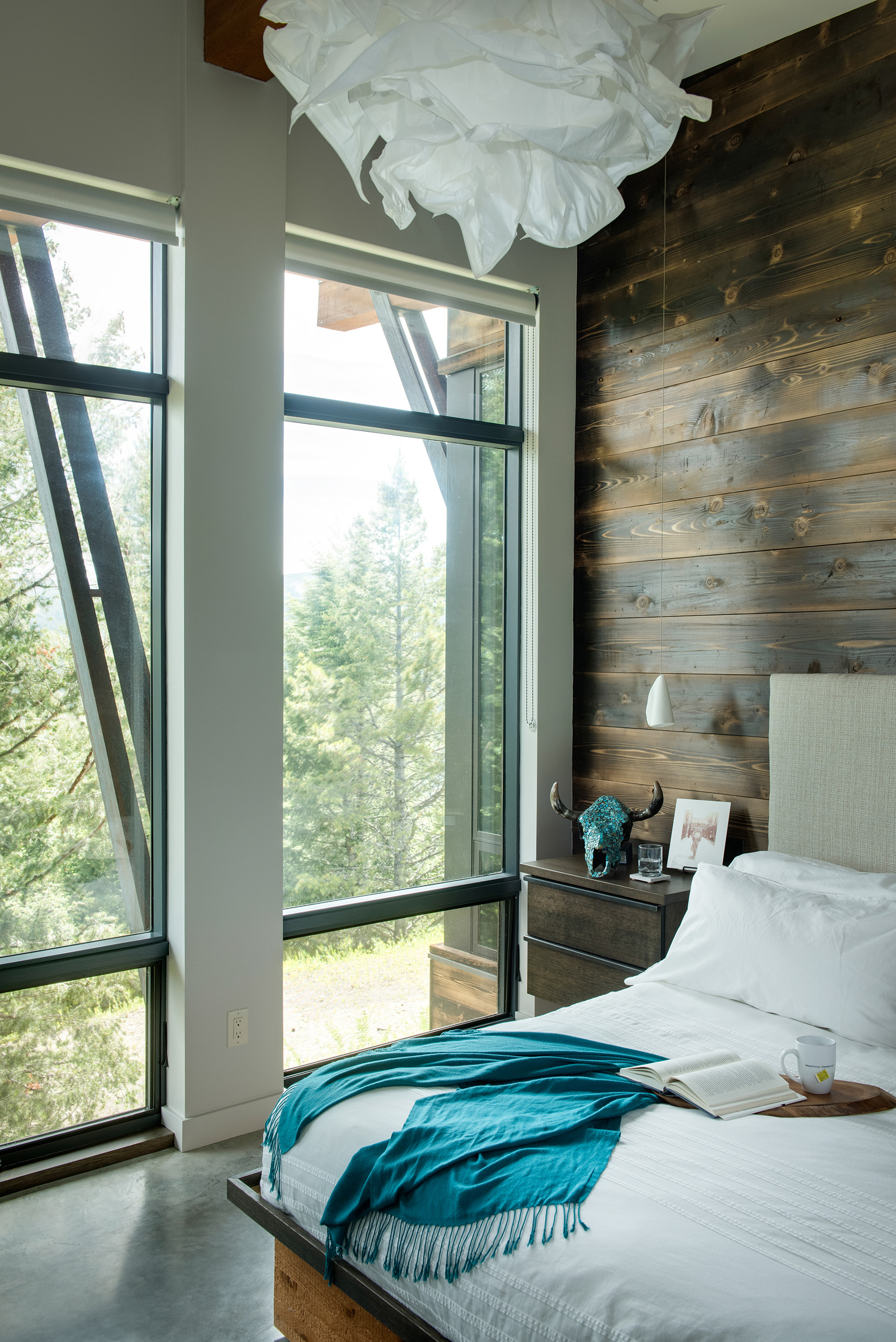 The walls and windows are spectacular in the master bedroom.