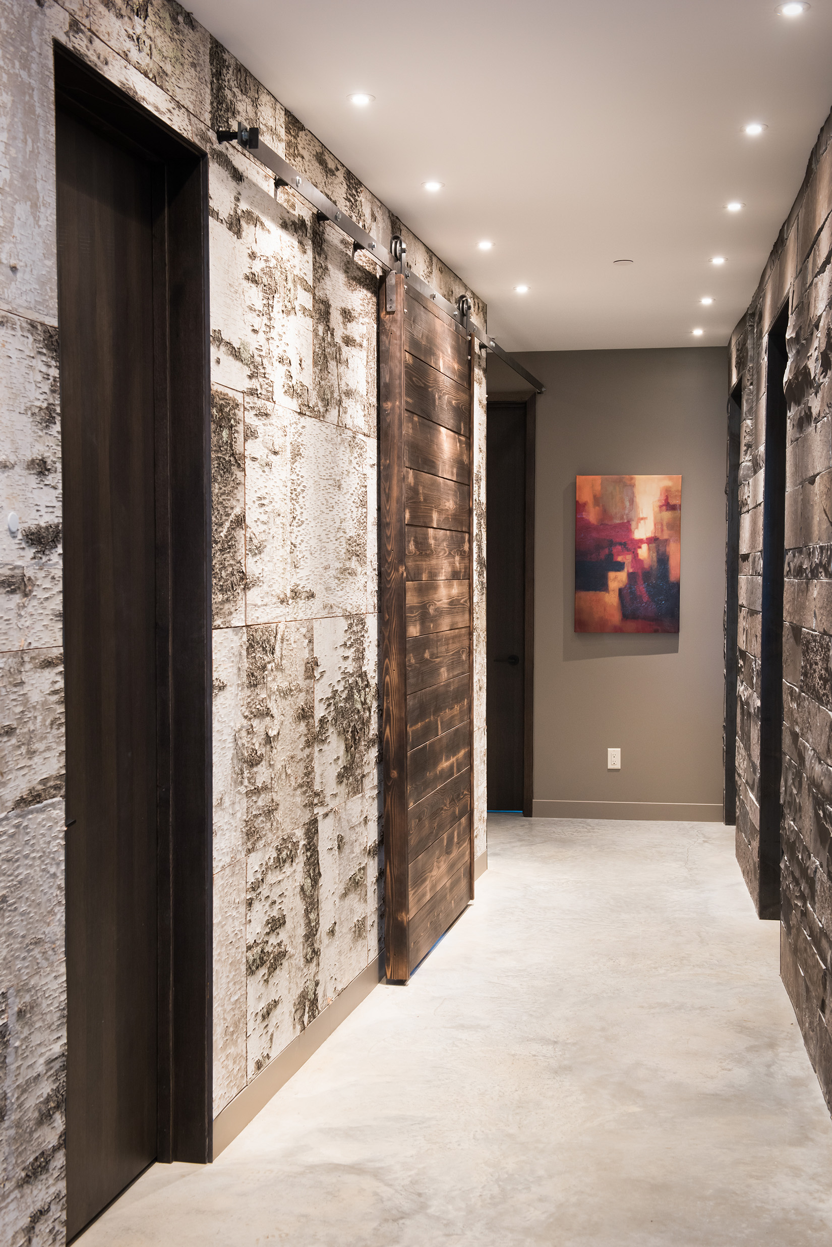 The perfect mixture or birch wallpaper, timber, and stone.