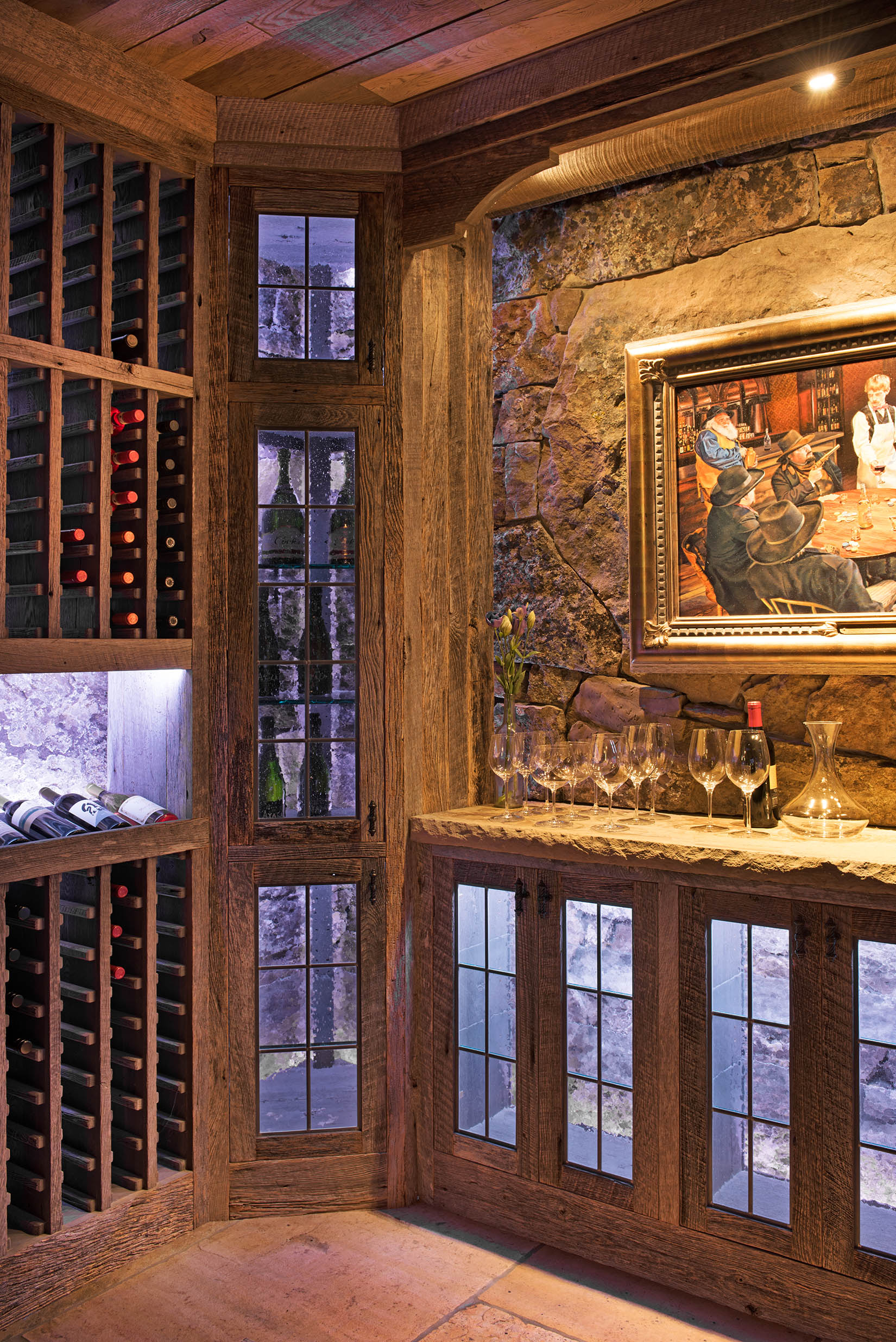This bar/wine cellar was located in the lower level of a gorgeous home in Bozeman.  The stone and rock gives off the feel of a wine cellar in the Chianti region of Italy.