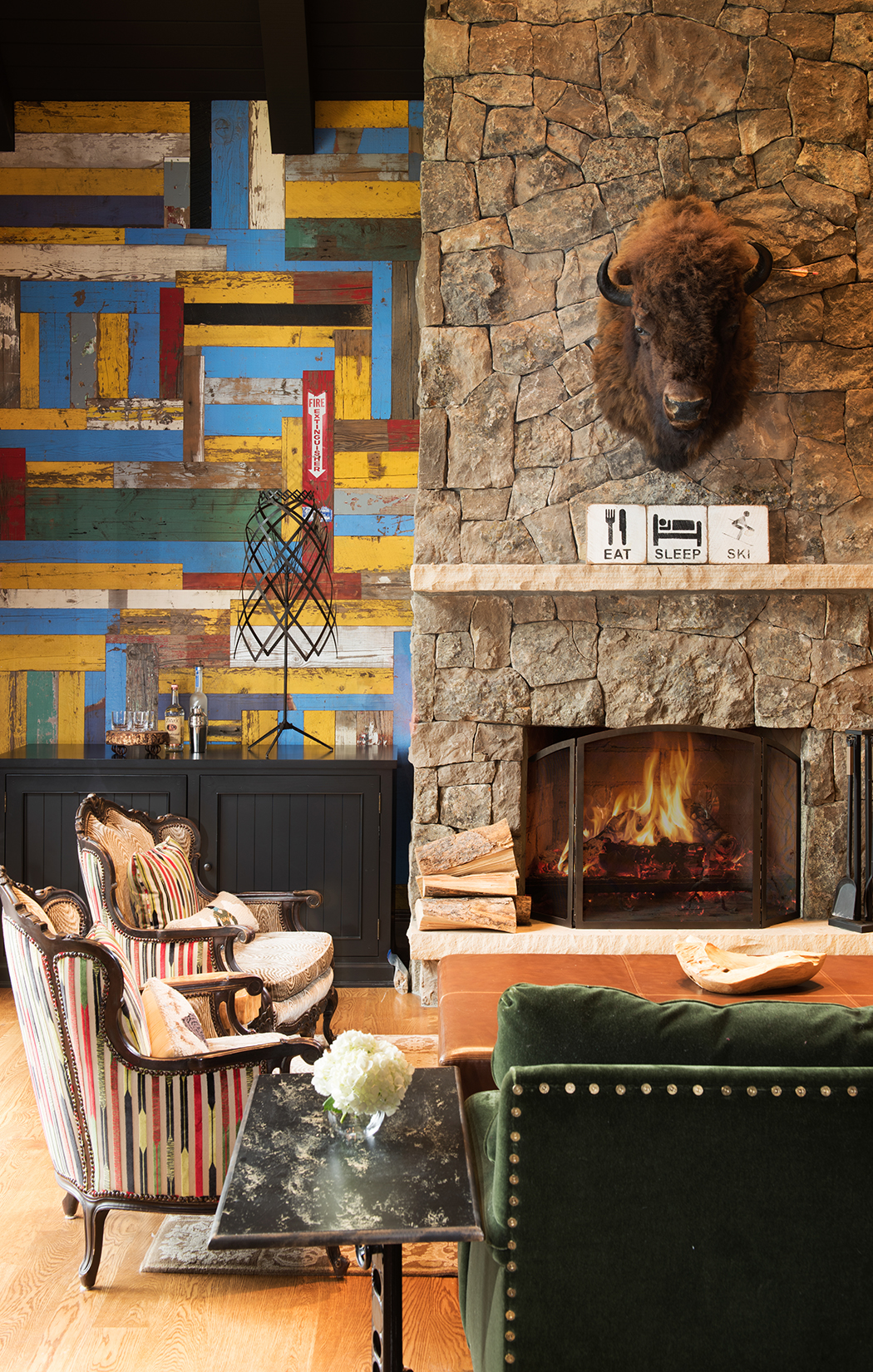 The colorful barn wood wall is what I love in this great room at  Yellowstone Club . It adds a sense of playfulness to this room.