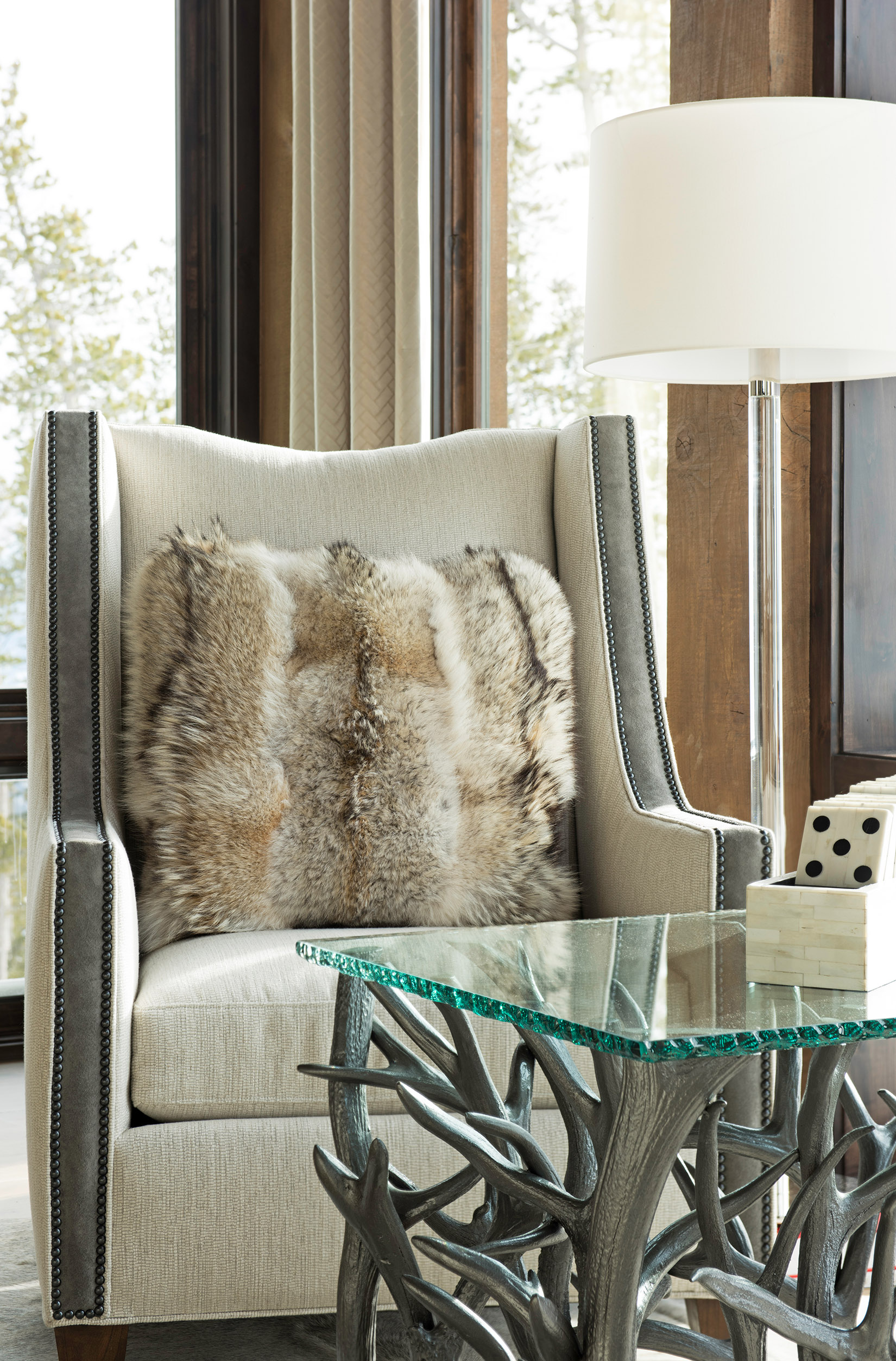This cozy corner looks out at the ski hill at  Yellowstone Club . I love the pillow and the gorgeous table!! Interior Design -  Varda Interiors