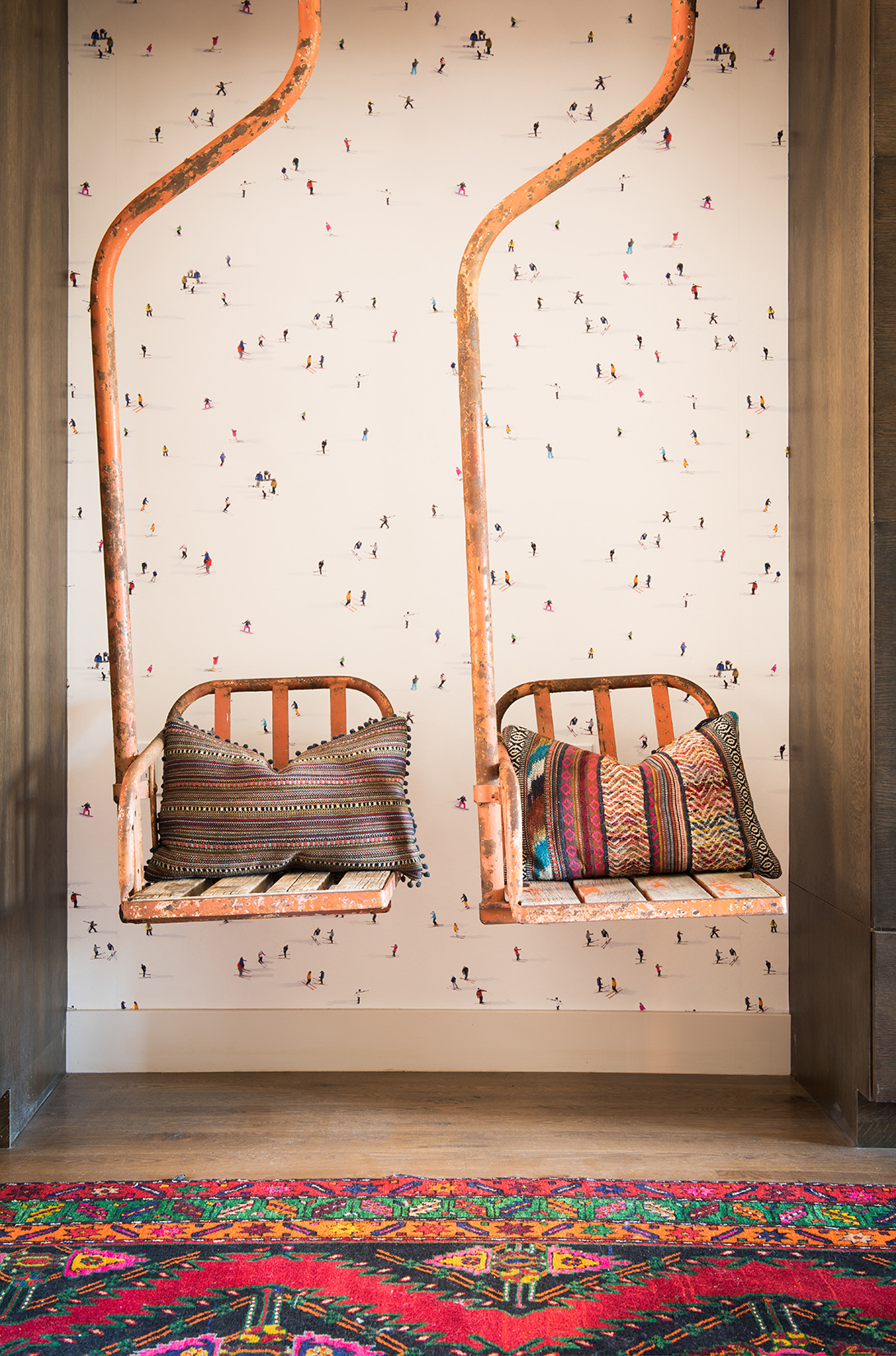 YES!! Colorful and fun! I love the use of these old chairlifts in this entryway. The wallpaper is a nice touch too! Interior Design -    Carole Sisson Designs