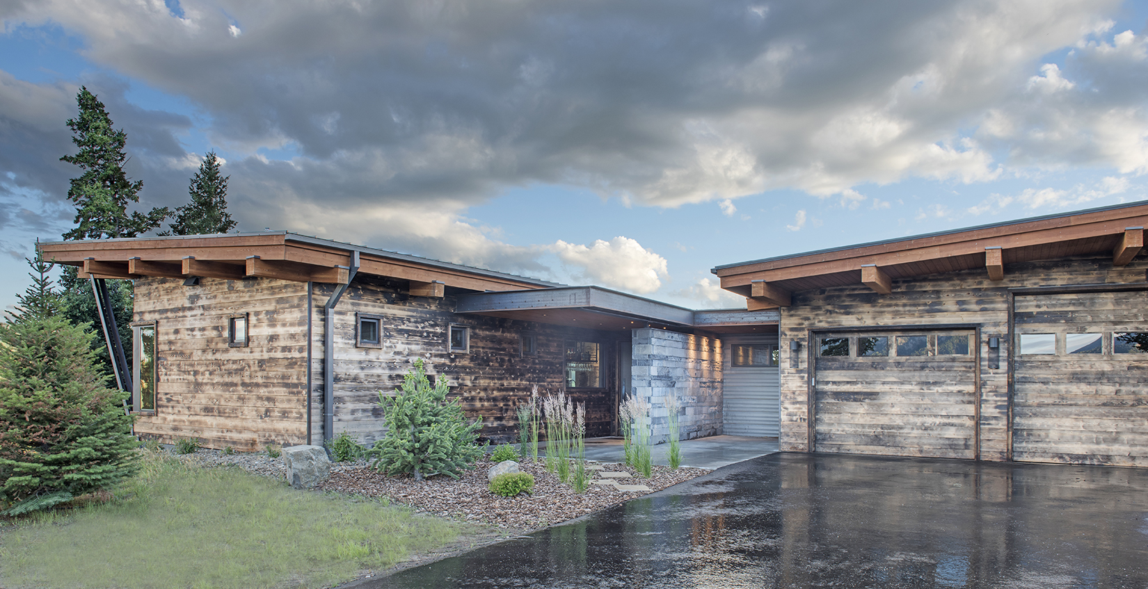 I love the charred wood of this beautiful, mountain contemporary home in Spanish Peaks Mountain Club.  Architect -  Reid Smith Architects , Builder -  Big Sky Home Builders