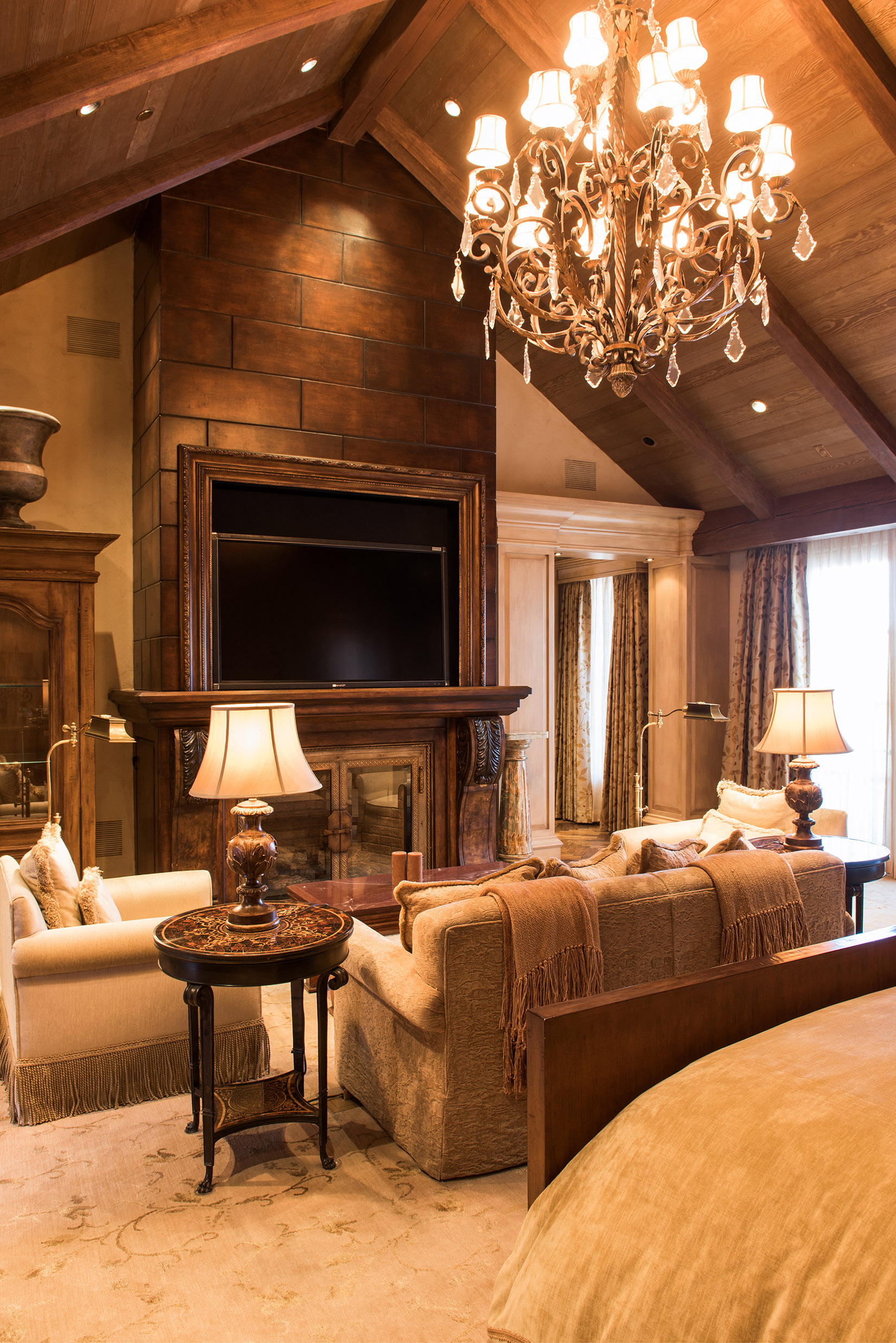 The master bedroom is a great place to relax with the tall, vaulted ceilings and grand fireplace.