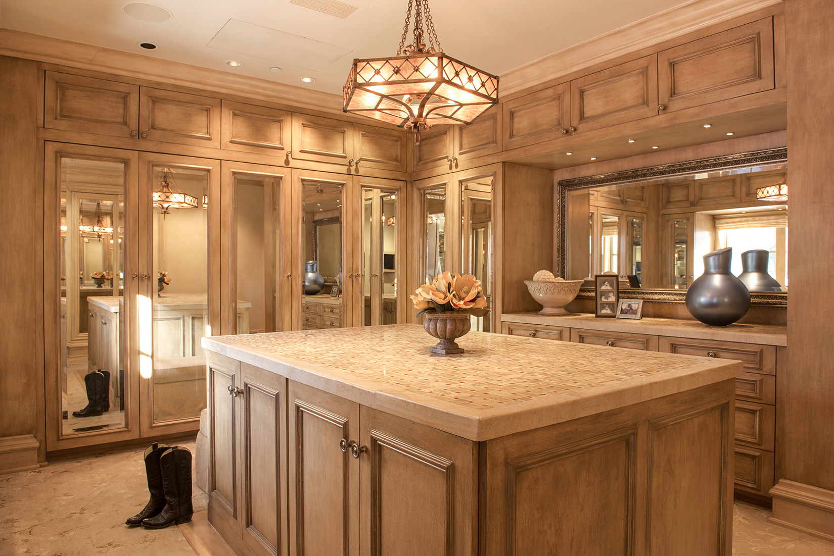 Just off the master bath and bedroom is this amazing closet with wrap around storage and full length mirrors.