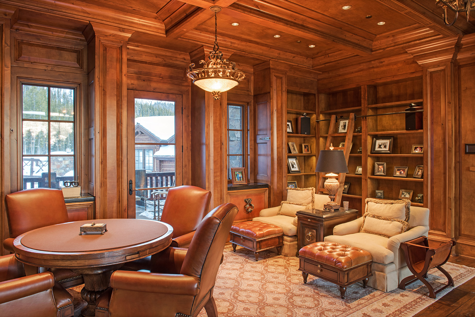 The classic library has it's own private deck and looks out over the great room.