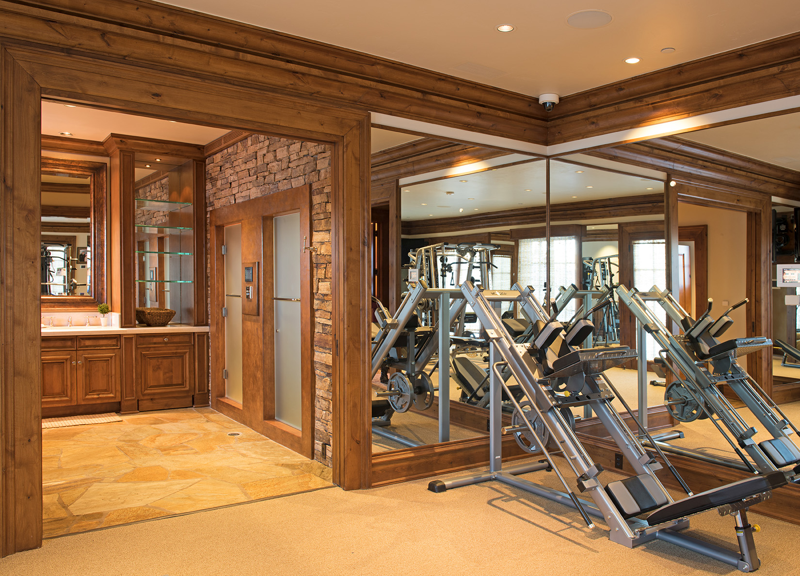 Huge work out room and steam shower with walk out access to the hot tub.