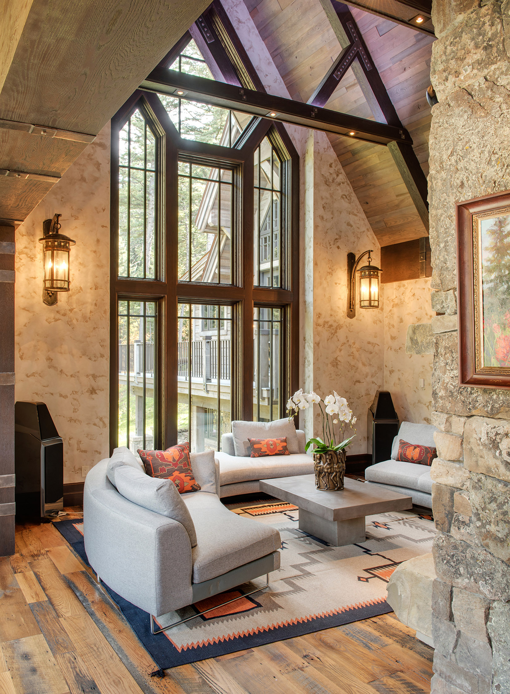 The entry of the home opens up to this stunning great room with floor-to-ceiling windows. I love the furnishings in this room too!