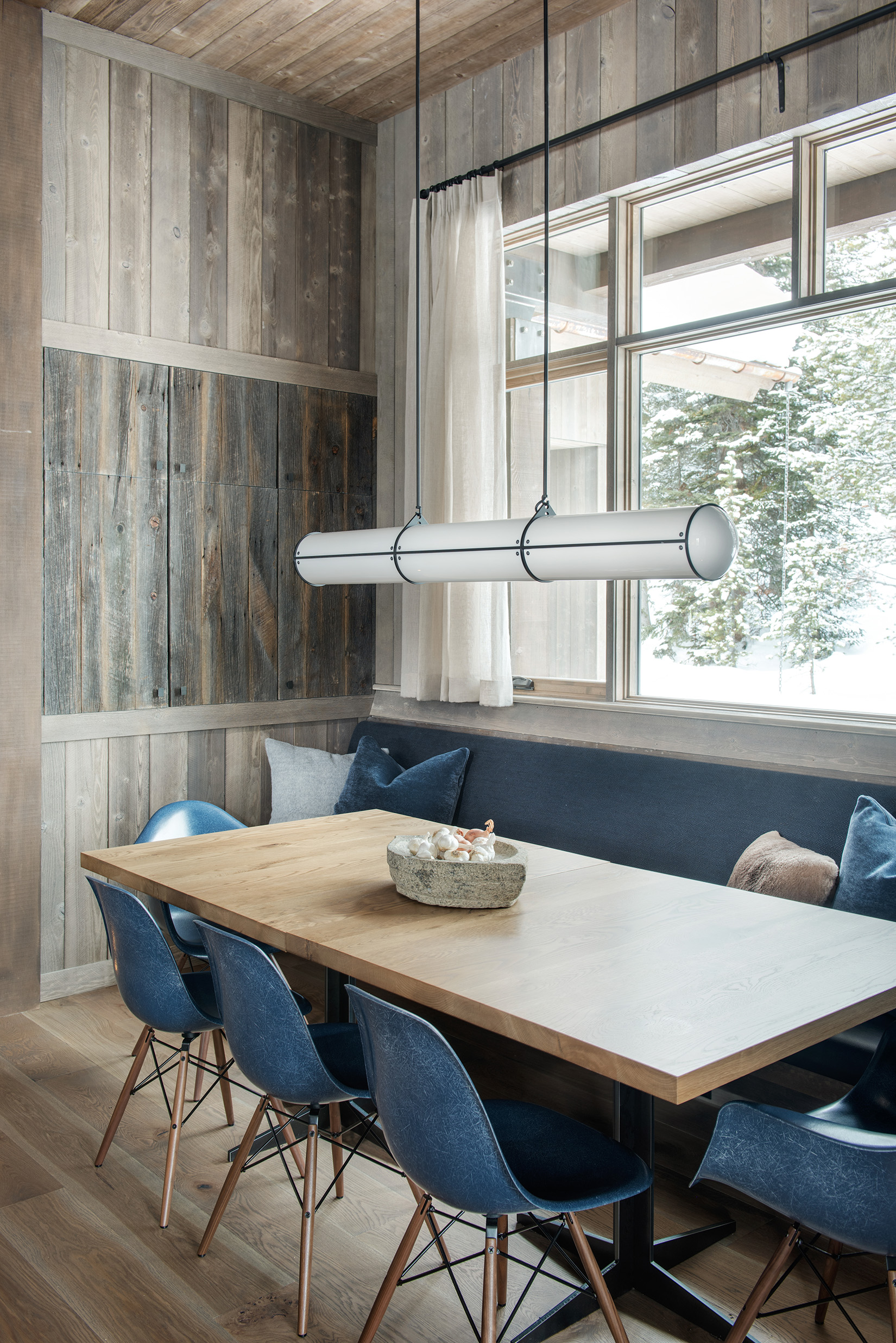 The dining nook was one of my favorite spots in the house. The rustic wood beams and modern lights and furnishings compliment each other very well!