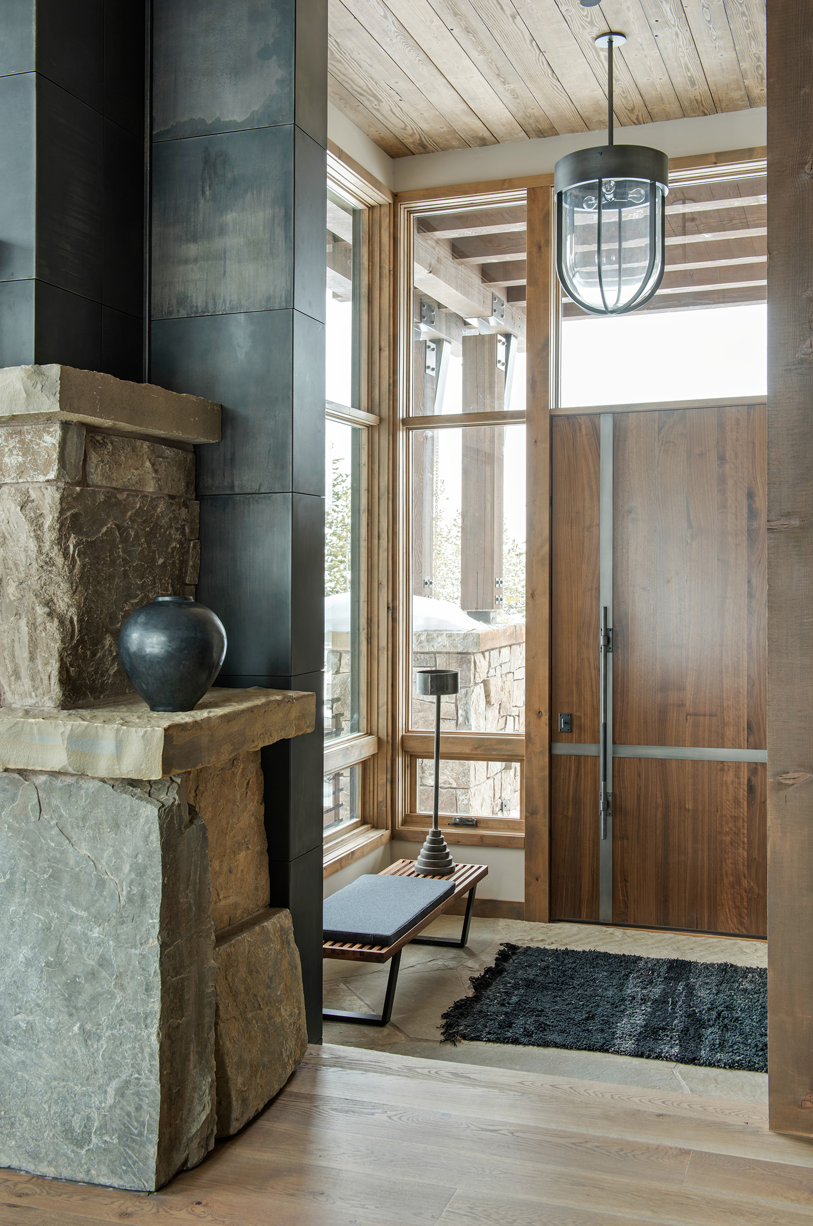The entry is the first space you see when you walk into a home so it should be designed to impress. Nothing short of impressive with this stunning entry. Again, the wonderful combination of the stonework, wood, and steel beams show off the creativity and talent of the architect.