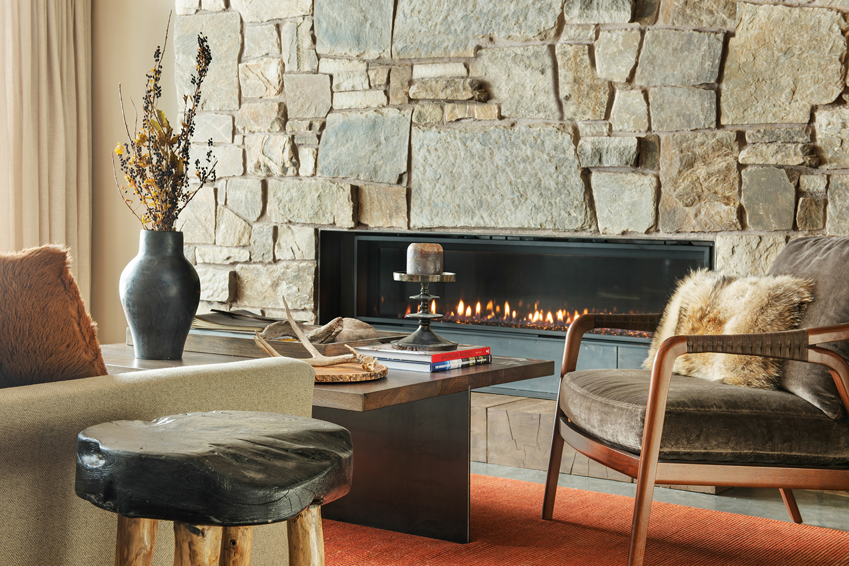 The modern fireplace adds to this cozy lower level sitting area.
