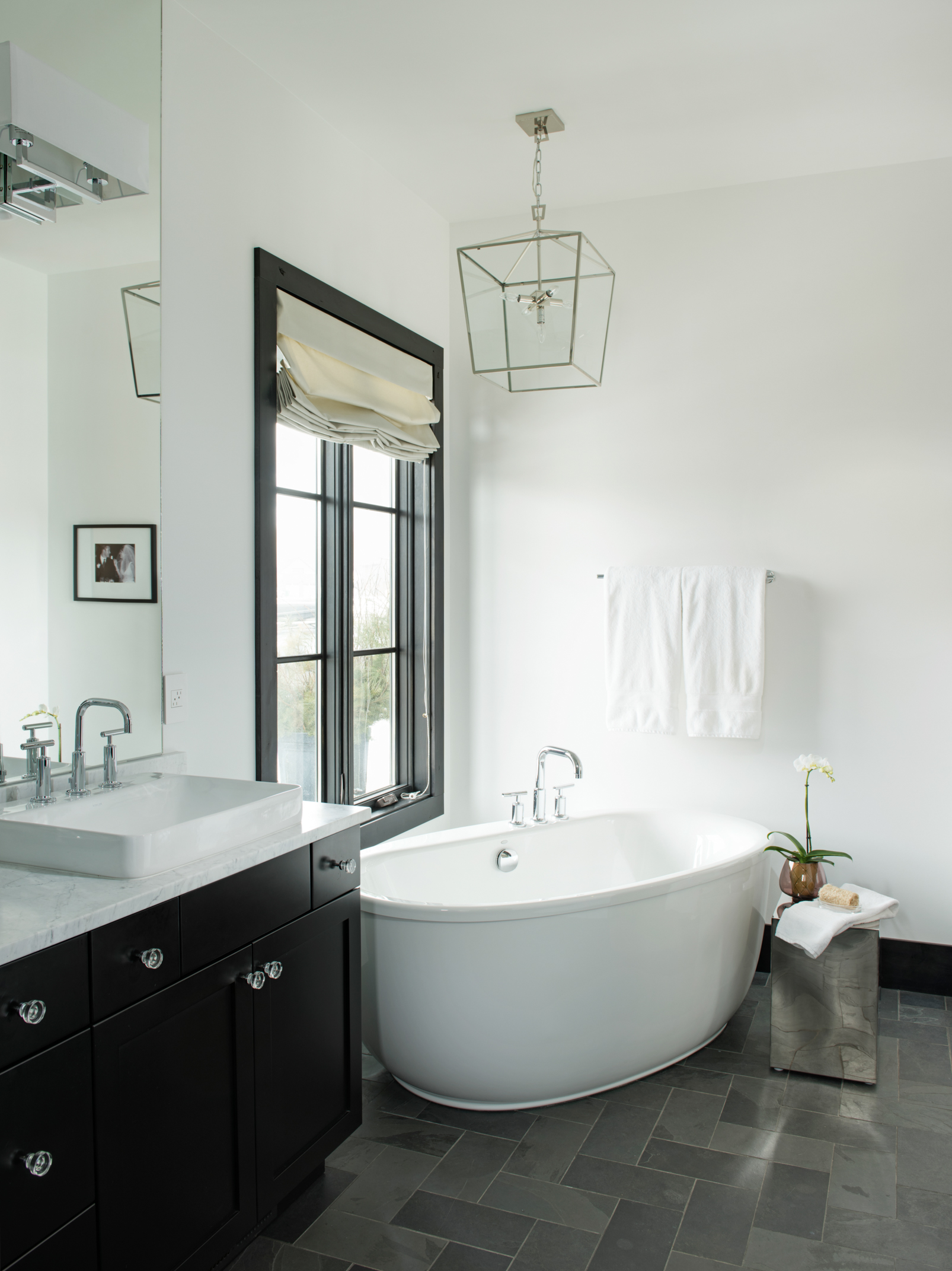 This bath is STUNNING! I love the simple and classic blacks & whites, and that tub!!