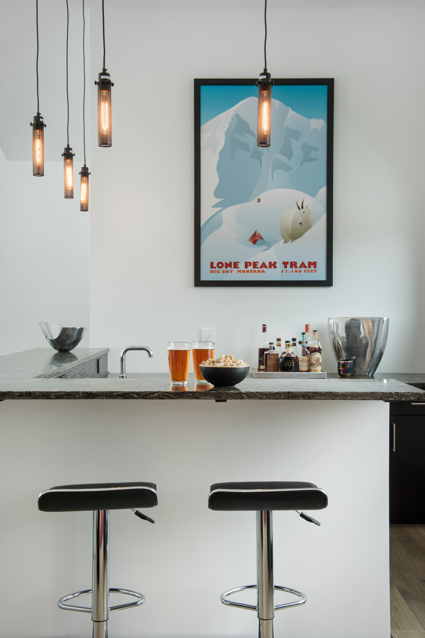 What's a house without a custom bar? The bar feels so sophisticated and bright - the perfect place to have a cocktail!