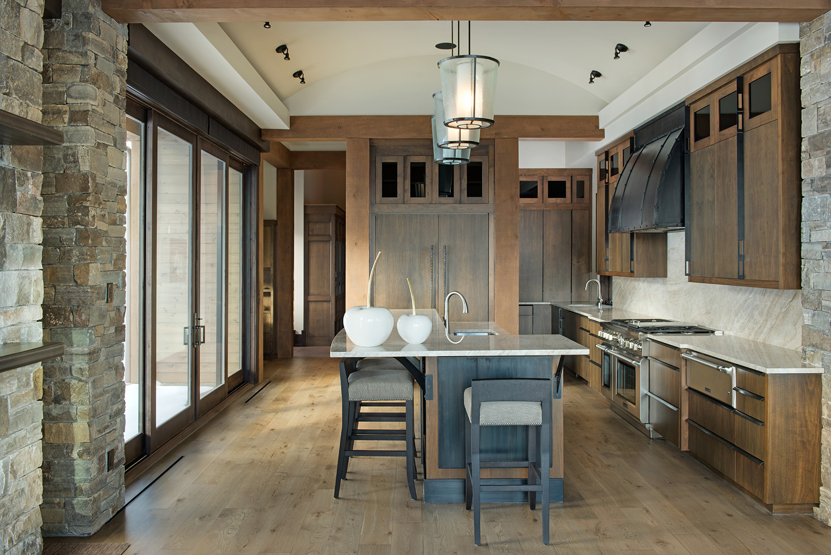 This kitchen blends the rustic tones with a contemporary look. Design by  Varda Interiors