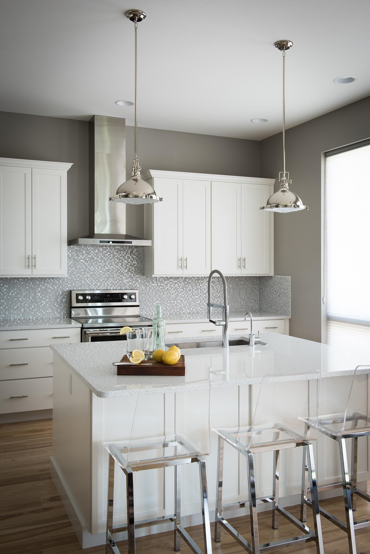 The bright & airy feel is what draws me to this stylish kitchen. General Contractor - Trademark Construction