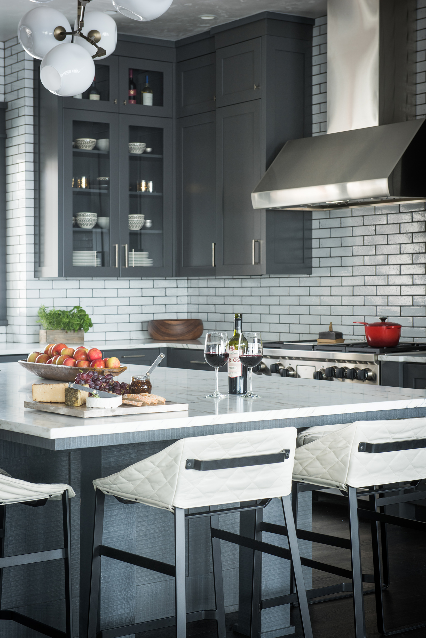 I love the subtle pops of color in this stylish black & white kitchen! Interior Design by  Karen Bow Interiors